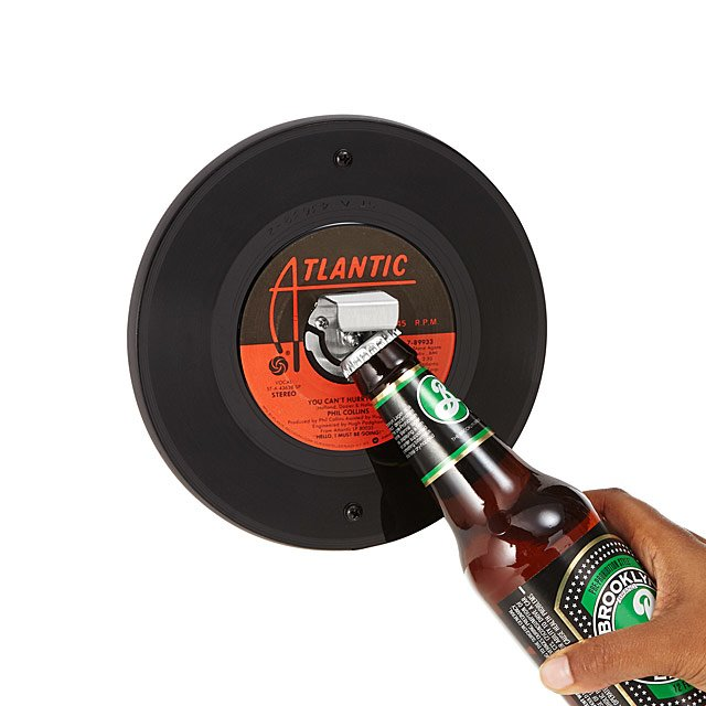 Record Bottle Opener - These wall-mounted bottle openers are made from real vintage vinyl records — you can choose from rock, soul, country, or 80s, but the artist and song will be randomized. Definitely a cool piece for the kitchen… or your bedroom.