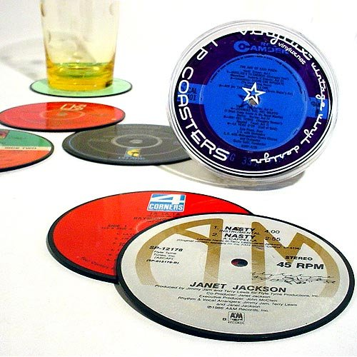 Record Coasters - Be a good host (and avoid coffee table rings) with these vinyl record coasters. They're not just designed to look that way — they really are made from real records! One set includes six coasters from a variety of artists.