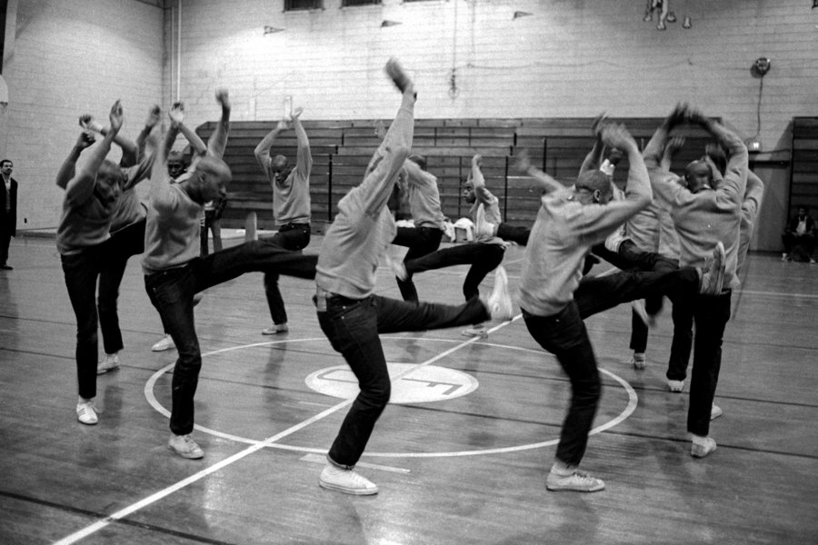 Fraternity pledges for Omega Psi Phi practice their stepping routine in the Fisk University gymnasium1969.jpg