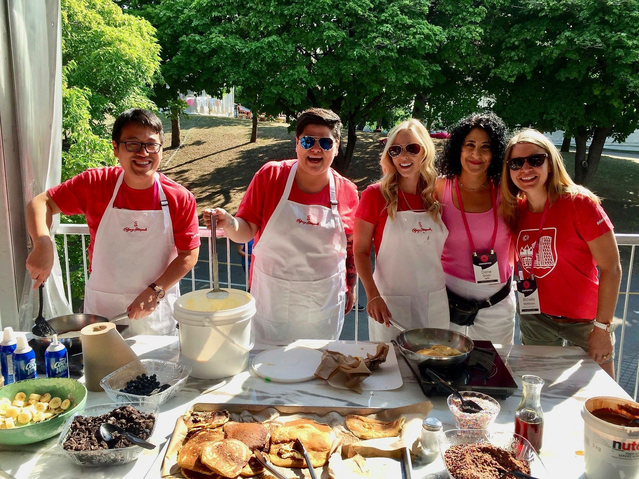 Members of the Calgary crew flipping and serving pancakes sponsored by Calgary Stampede. L to R: Jonathan Chan (ShareSmart), Bobbie Racette (Virtual Gurus), Jenn Delconte (Startup Calgary), Dena Shlah (IGBA), Richelle Martin (Calgary Technologies Inc.)