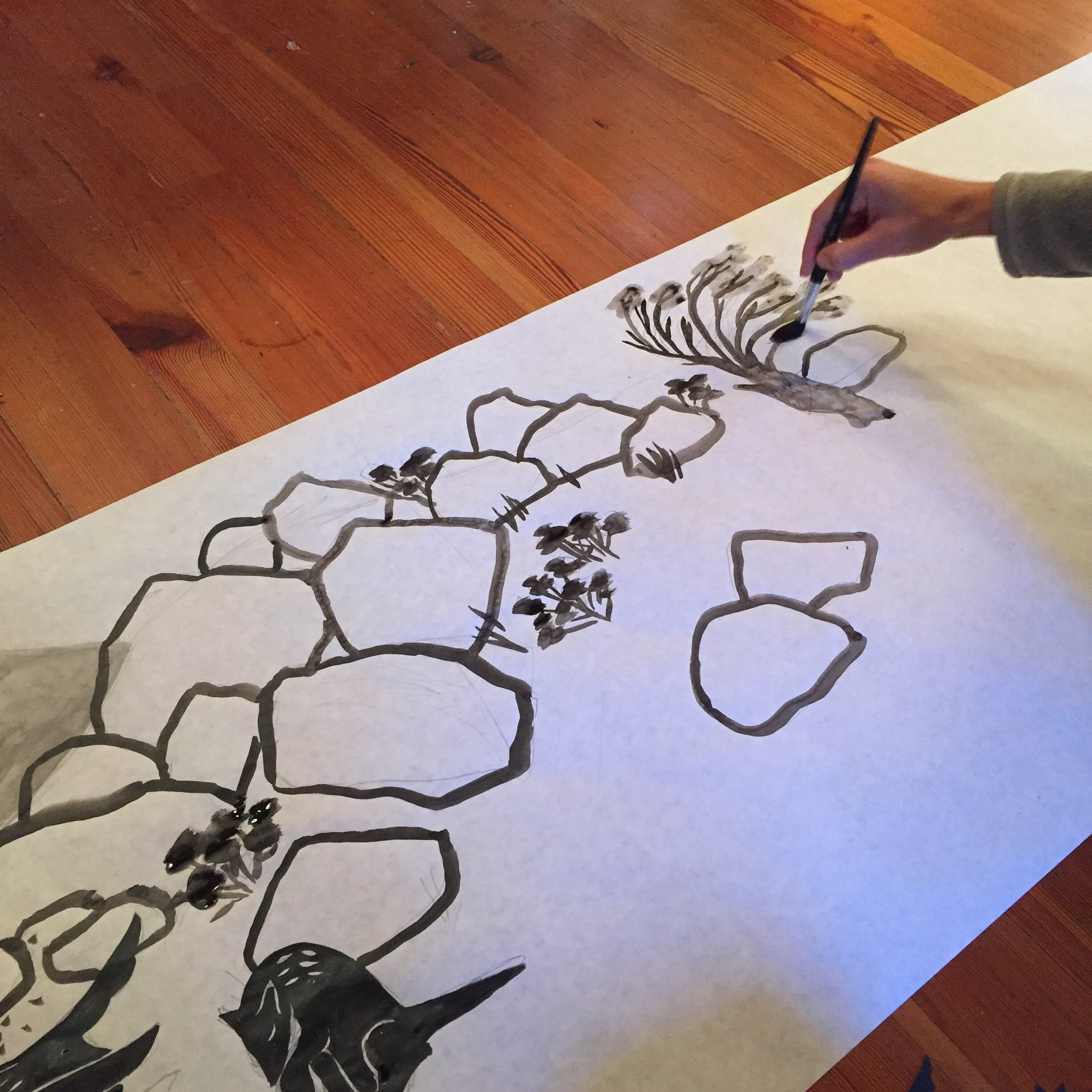 Painting with India ink.