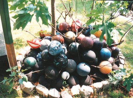 Bowling Ball Collection Unis,  1995, bowling balls, found sticks, and rock circle, dimensions variable