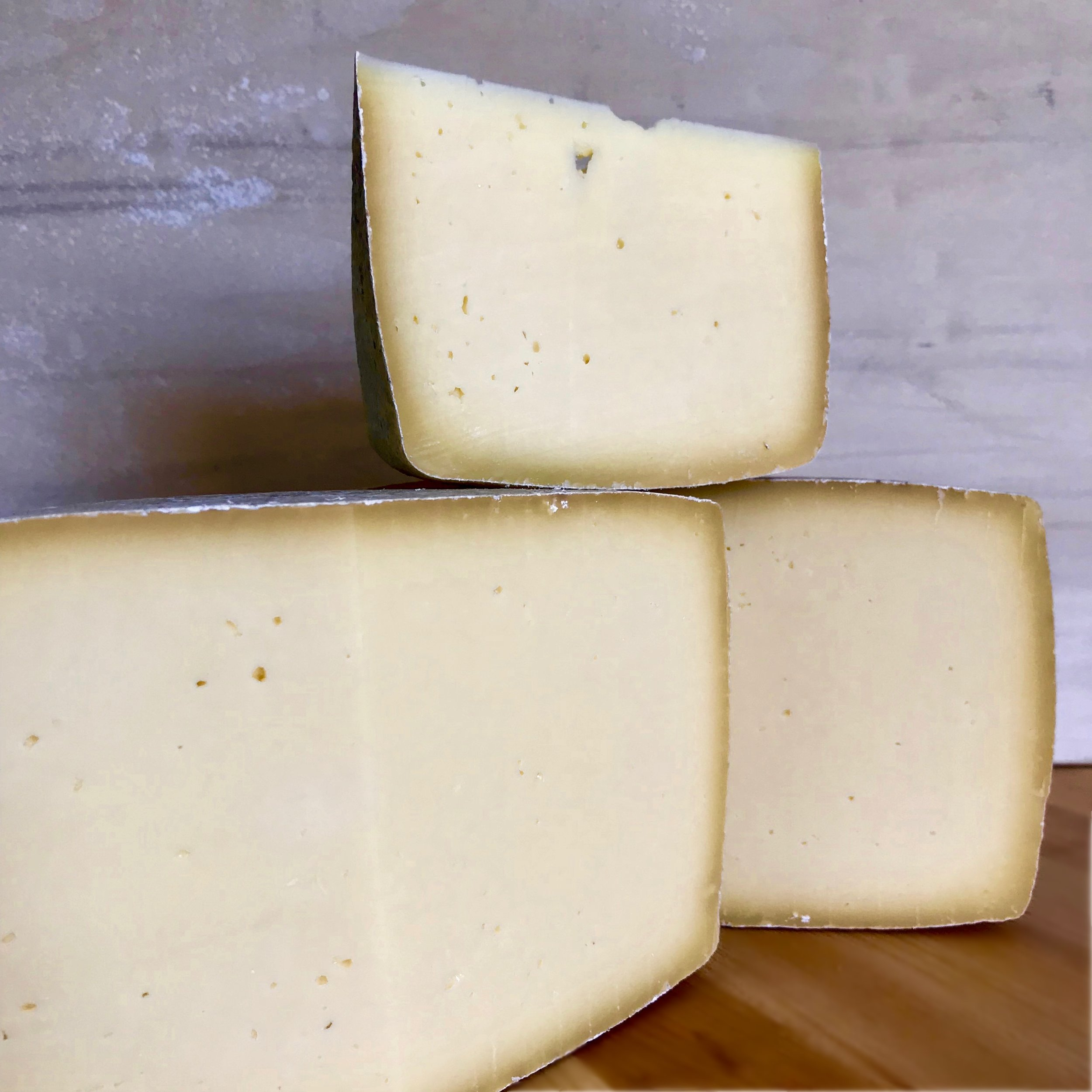 Wild Thing - Wild Thing is a pure expression of our backyard raw milk and microbes. We use both mesophilic and thermophilic cultures made from the microbes that live on udders and in the grasses of our pastures. It takes 7 gallons of mixed goat and cow milk to make one 8 pound square stone that ages well for 4 to 6 months. Her rind is natural and her paste is semi-hard, with a creamy texture. Her flavors are milky, straightforward, clean, and pure, gaining complexity as she ages.Wild Thing is part of a cheesemaking revolution. Find out about the revolution here!