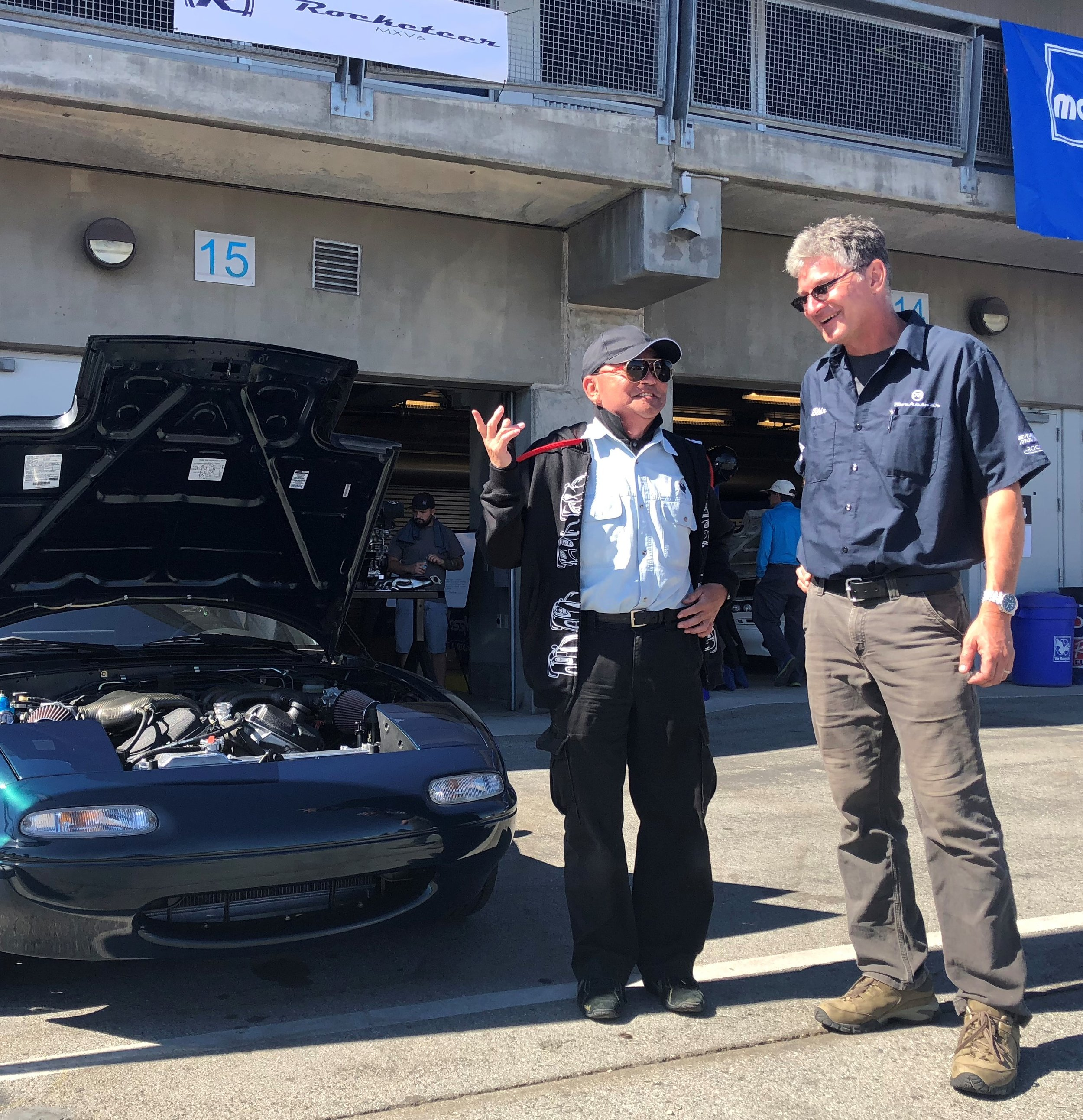 Blair, with Miata designer Tom Matano at Laguna Seca.