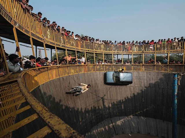 At the 2019 #kumbhamela in #Allahabad, #India - 150 million #pilgrims gathered over a period of 48 days in a #celebration of #peace and harmony. The scene depicted here is from the #WallofDeath. #Stuntmen on #motorcycles and cars ride around the wooden cylinder, defying gravity through the manipulation of friction and centrifugal force. - @josejeuland . . #wallofdeathwednesday #indiaphotography #exploreindia #visitindia #deathdefying #stuntman #camera #motorcycle #travelphotography #travel #amazingsights #incredibleindiaoffical #lonelyplanetindiaofficial #indialove #indianculture #inspiroindia #india_gram #indiagram #indiatravel