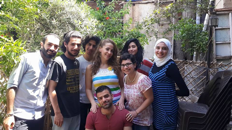 Hanin (center) with college students