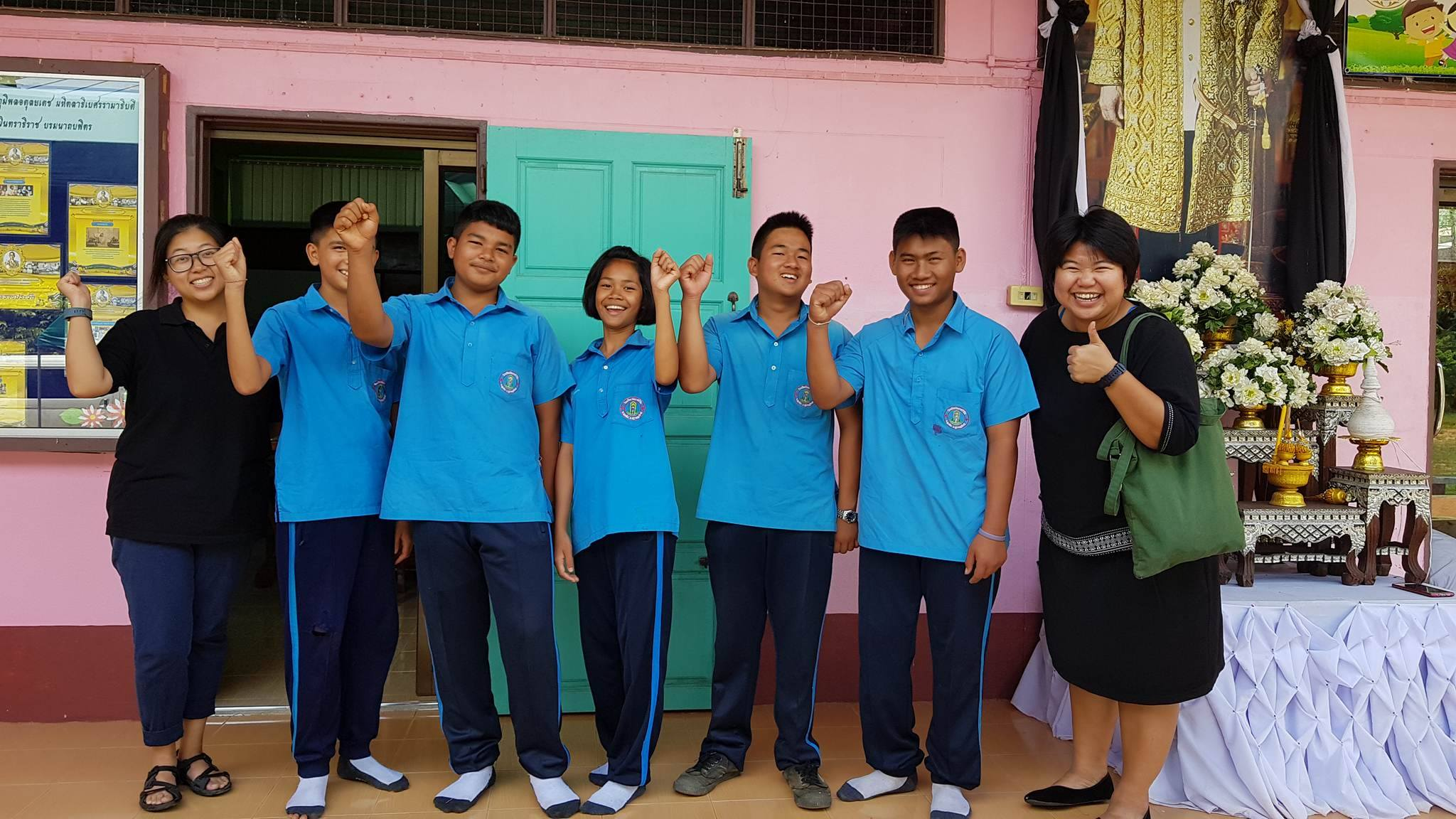 Pakou (left), her students, and Peace Corps TH Program Assistant