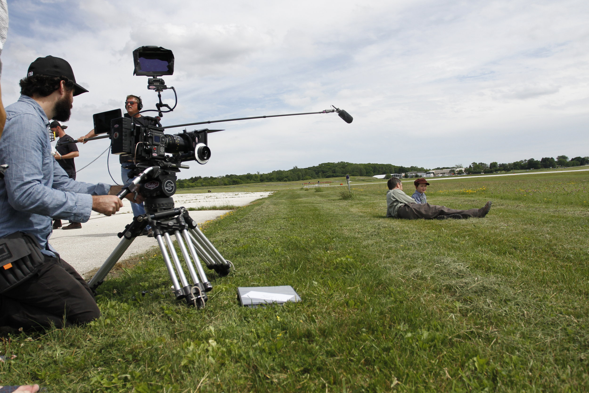 Filming a scene while the WWII plane flies above.