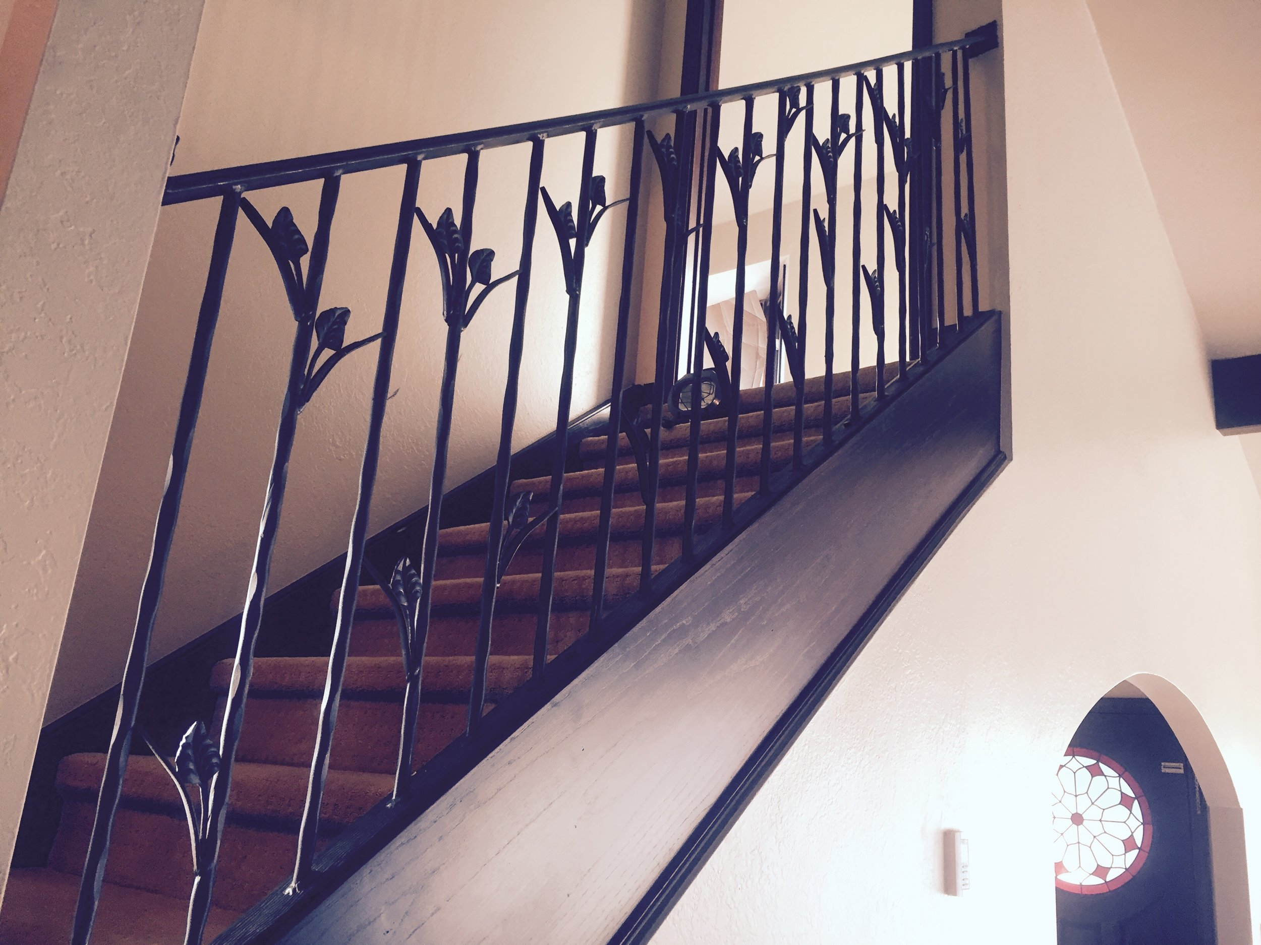 architectural metal work - Break up the wood in your home with a custom steel handrail railing. Choose from a vast assortment of decorative moldings and designs to create a special feel to your home.