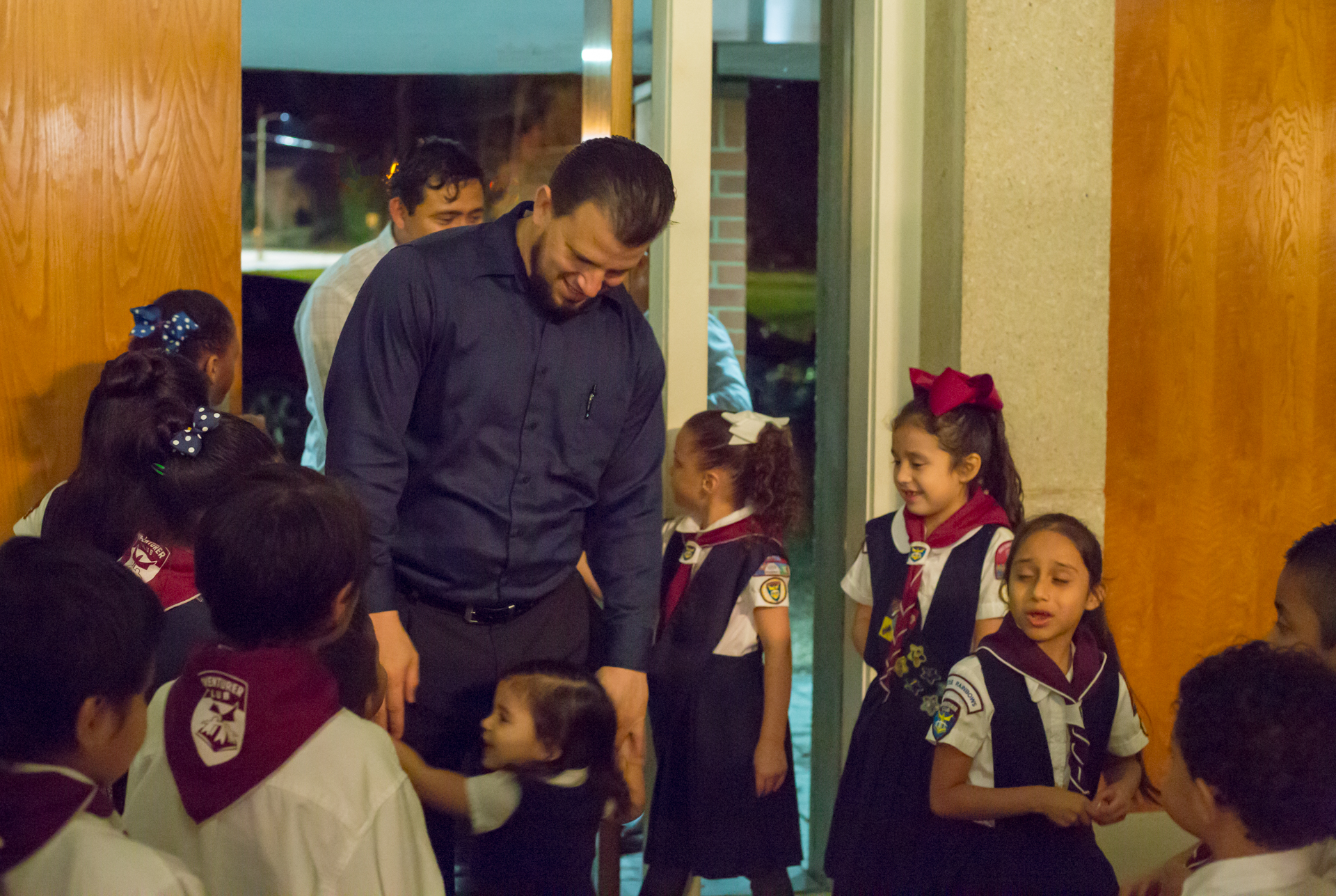 Michel Rodriguez, pastor of Montgomery Hispanic Church, is welcomed to his church by the Adventurers.