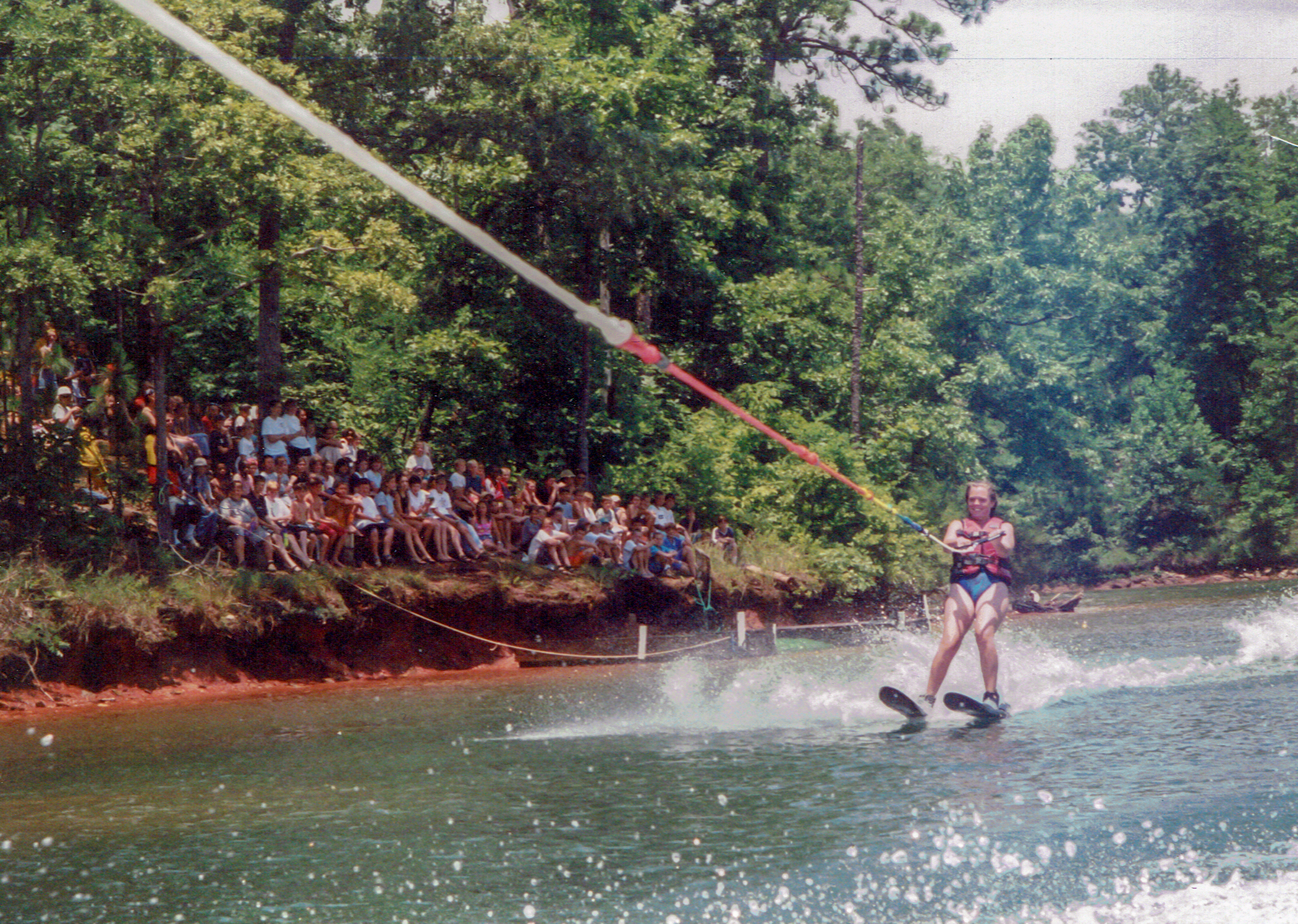 Spectators look on as young lady performs for the ski show on Lake Martin at Camp Alamisco.