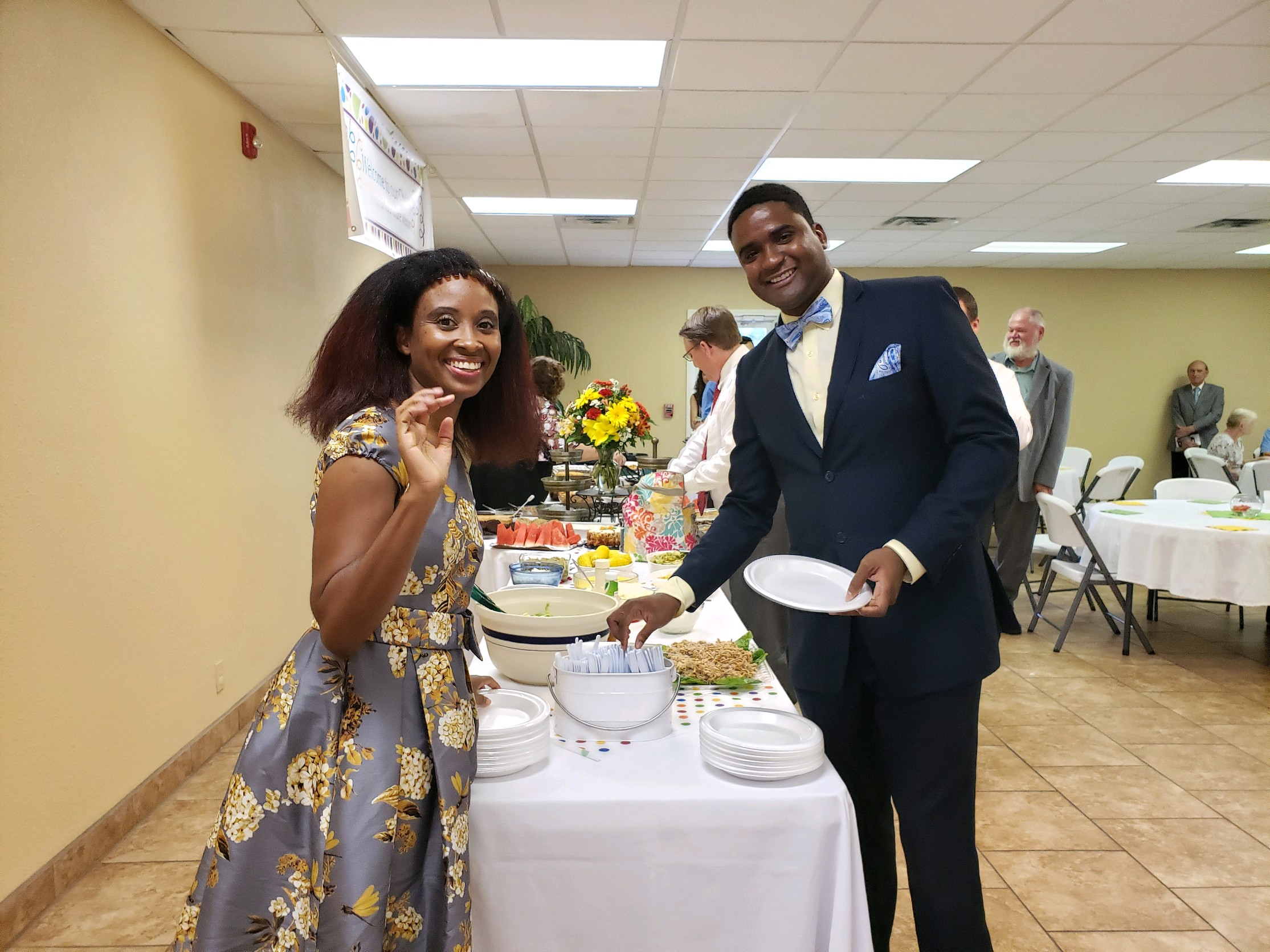 Nicole (left), and Andre Weston partake in the fellowship meal following their installtaion service at Bass Memorial Academy Church in Lumberton, Miss.