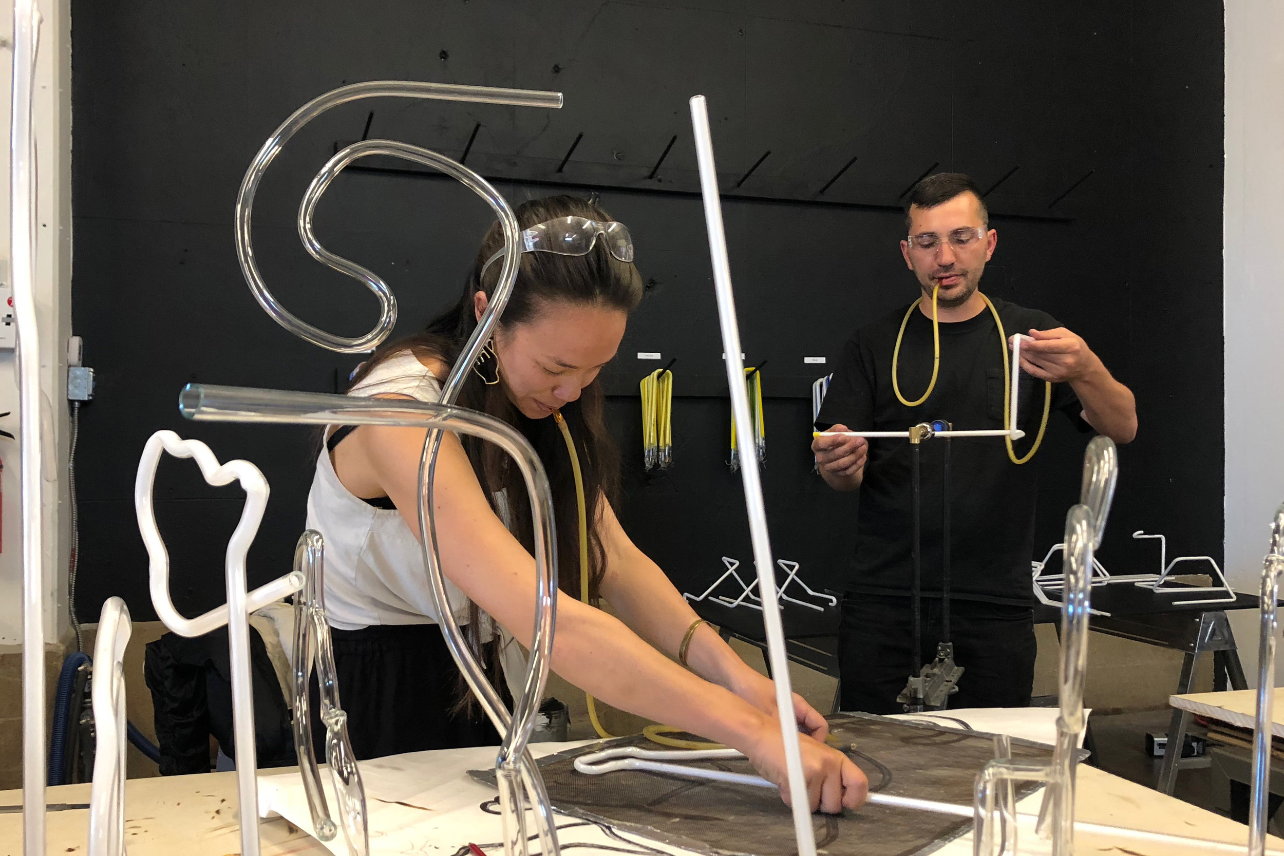 Celeste and Derek working on bends for their final pieces. Image  ©  2018 Western Neon School of Art.