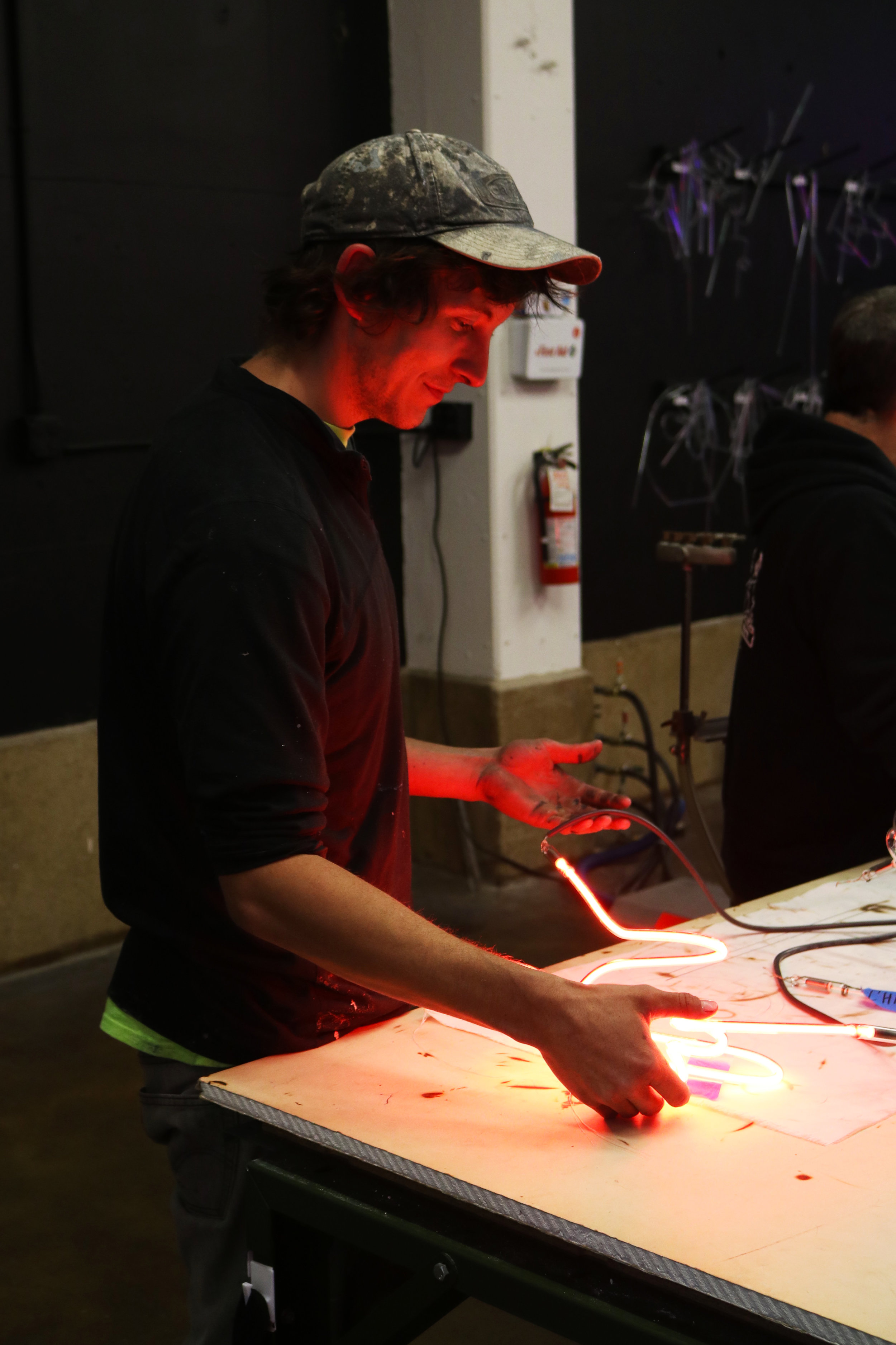 Tuesday student Chris holding one of his final pieces. Image  ©  2018 Western Neon School of Art.