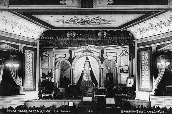 The three-story building included two retail stores on the first floor, an elegant theater on the second floor, and a third floor that connected to the adjacent Clarendon Hotel via passageway. The ornate interior boasted 72 gas jets (the first gas lights to illuminate Leadville), richly painted walls and ceiling frescoes, custom carpets, and hand-painted stage curtains.
