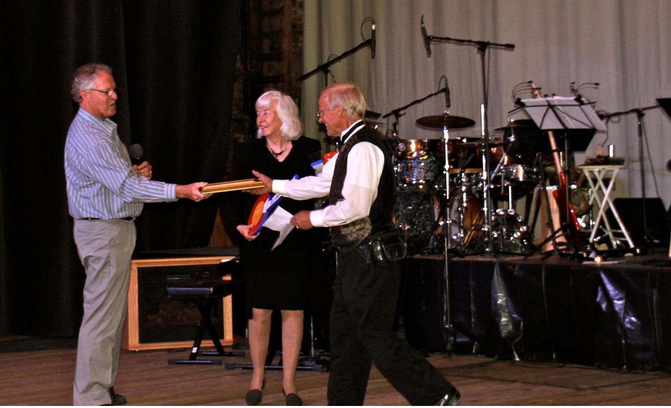 Mayor Jaime Stuever thanks Sharon and Bill Bland for their many years of service to Leadville operating the Tabor Opera House as private owners.