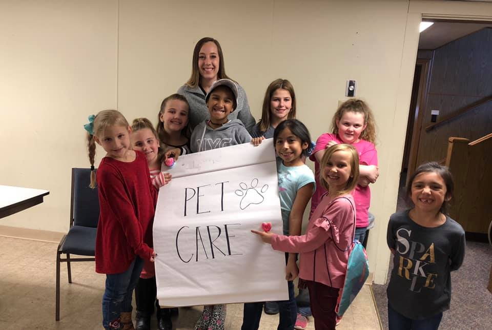 Dr. Blair Dingler met with Nocona Girl Scout Troop to discuss pet care so they could receive their pet care badge.