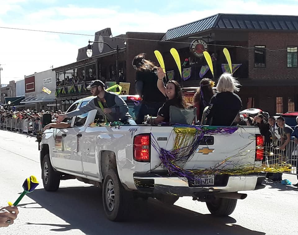 Several staff members rode in the Nocona Mardi Gras Parade to celebrate and support the event.