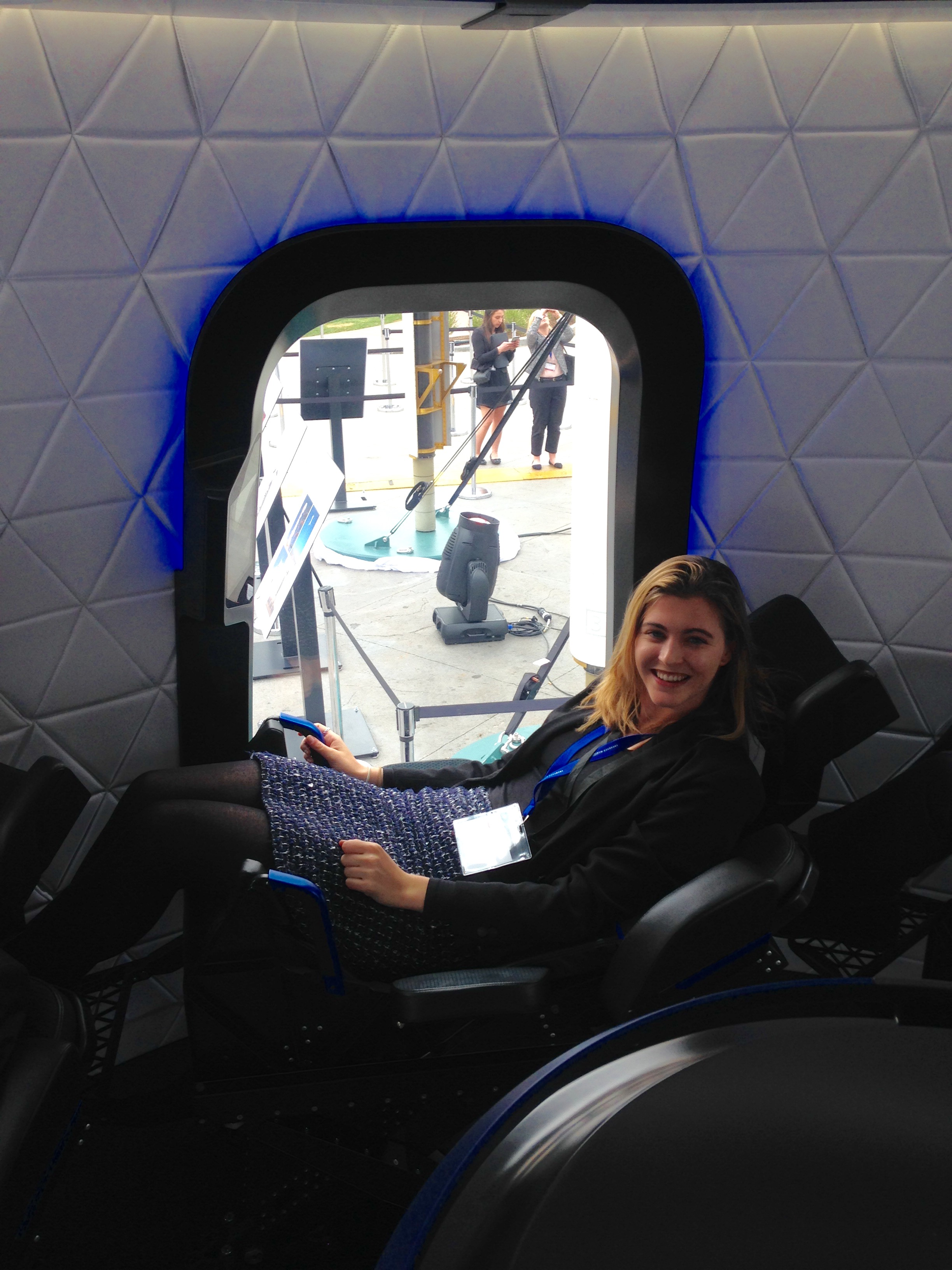 Space Symposium 2017 - sitting inside Blue origin space capsule.JPG
