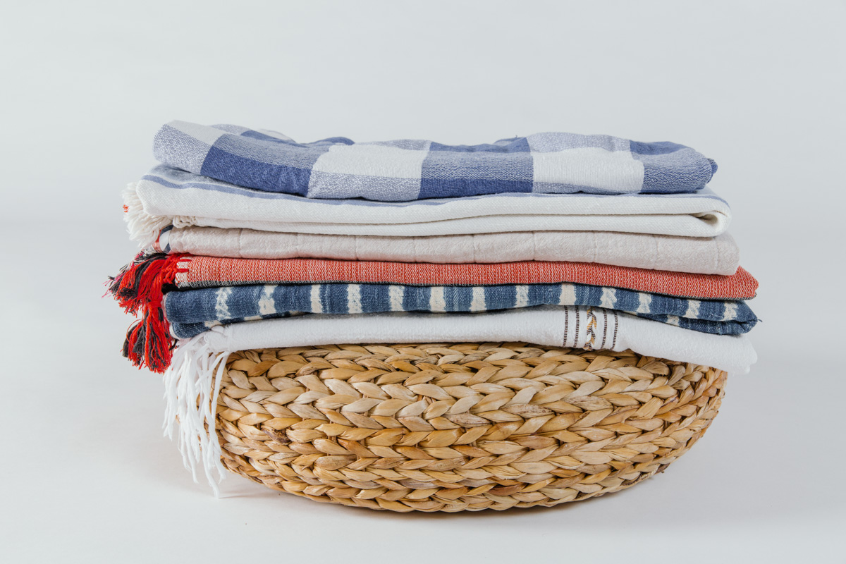 Rattan Pouf & Assorted Blankets