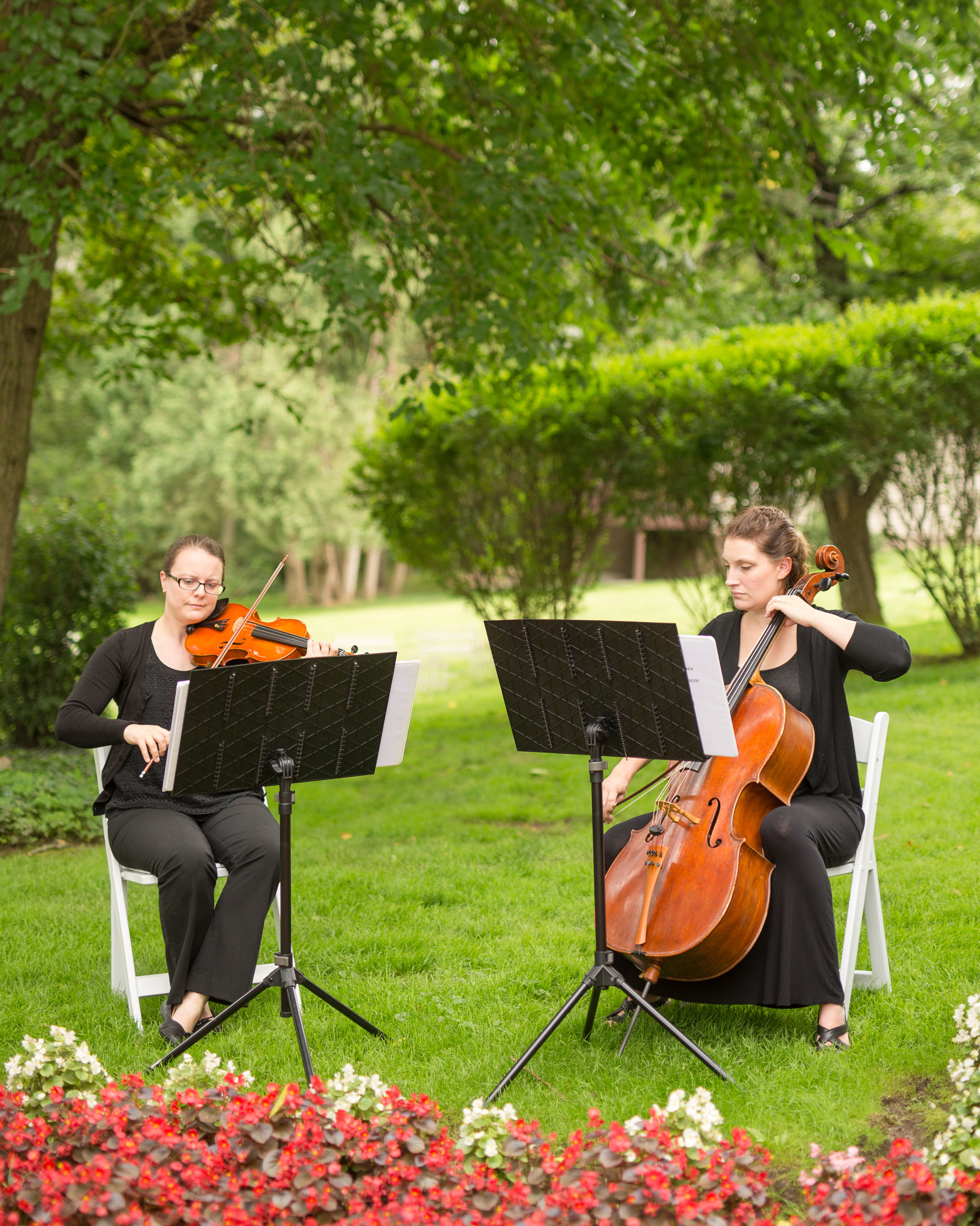 White Pines Entertainment String Duet performing for the ceremony. Photo by  Heather Kanillopoolos