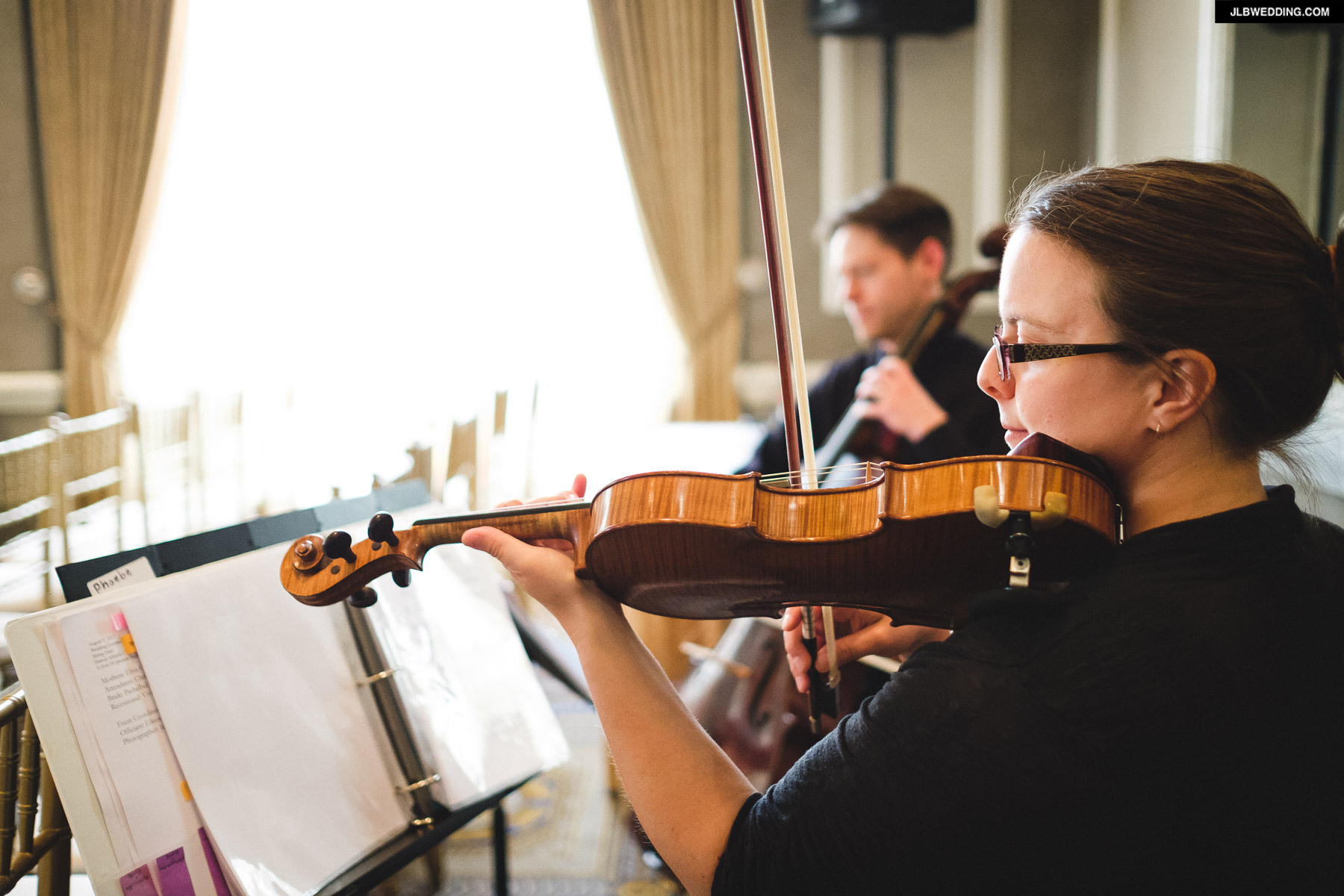 String Duet performing at a ceremony at the Detroit Athletic Club. Photo captured by Jeffrey Lewis Bennett of  JLB Photography