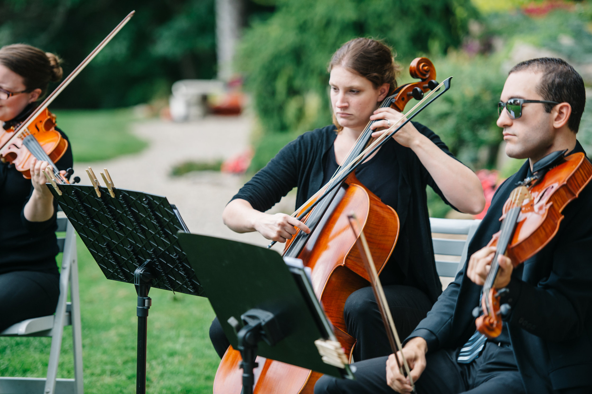 String trio performing in Rochester, Michigan captured by Amanda Dumouchelle Photography