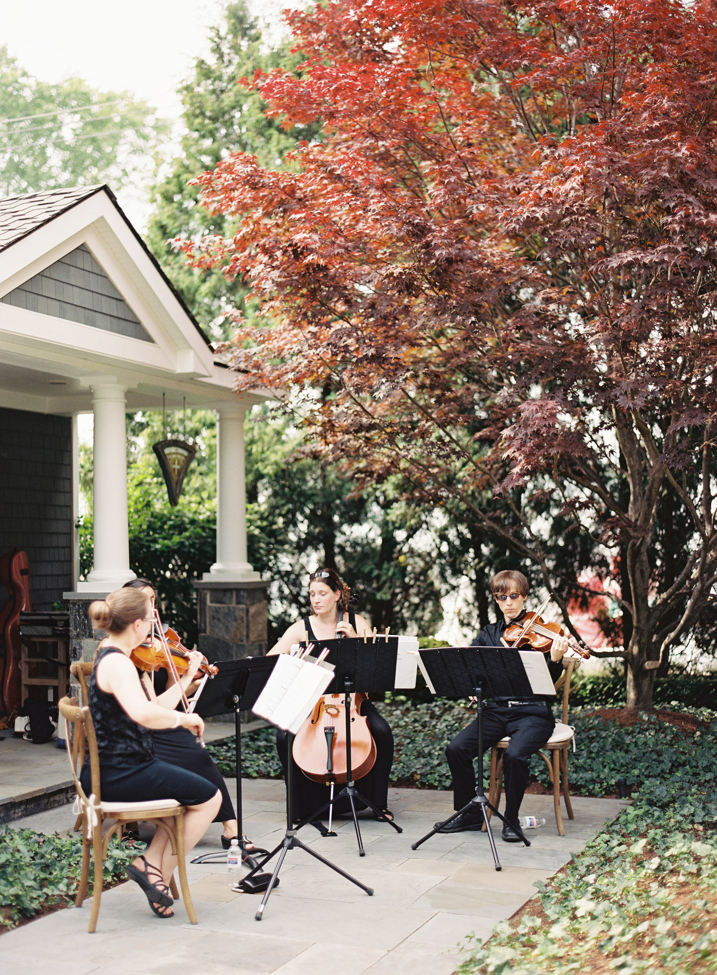White Pines Entertainment String Quartet captured during the ceremony by  Curtis Wiklund