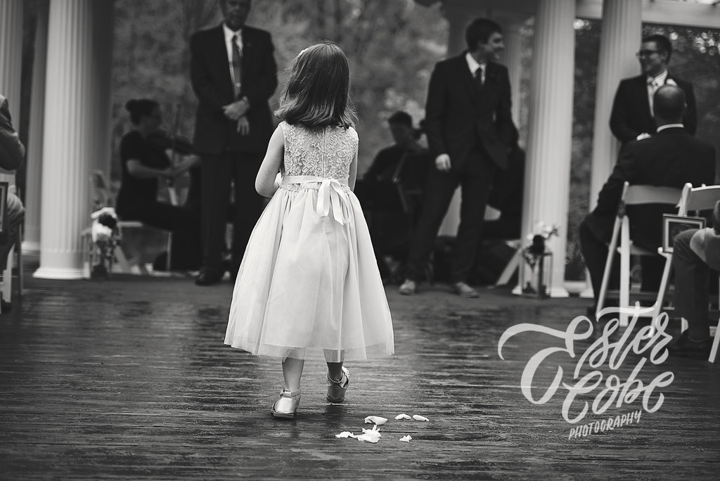 flower girl walks up the aisle