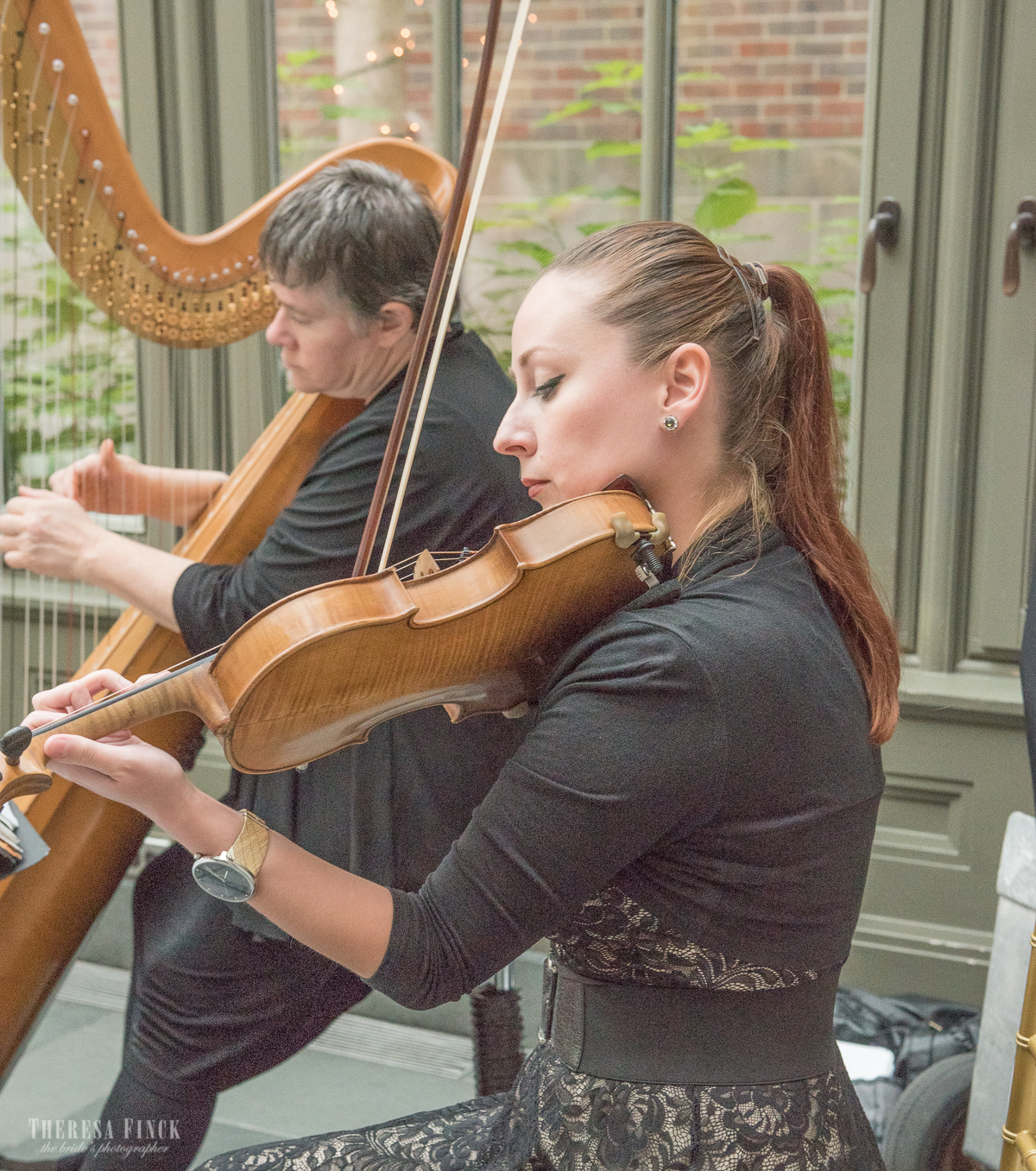 White Pines Harp and Violin Duet performing prelude music for a wedding ceremony in Rochester, Michigan. Captured by  Theresa Finck Photography