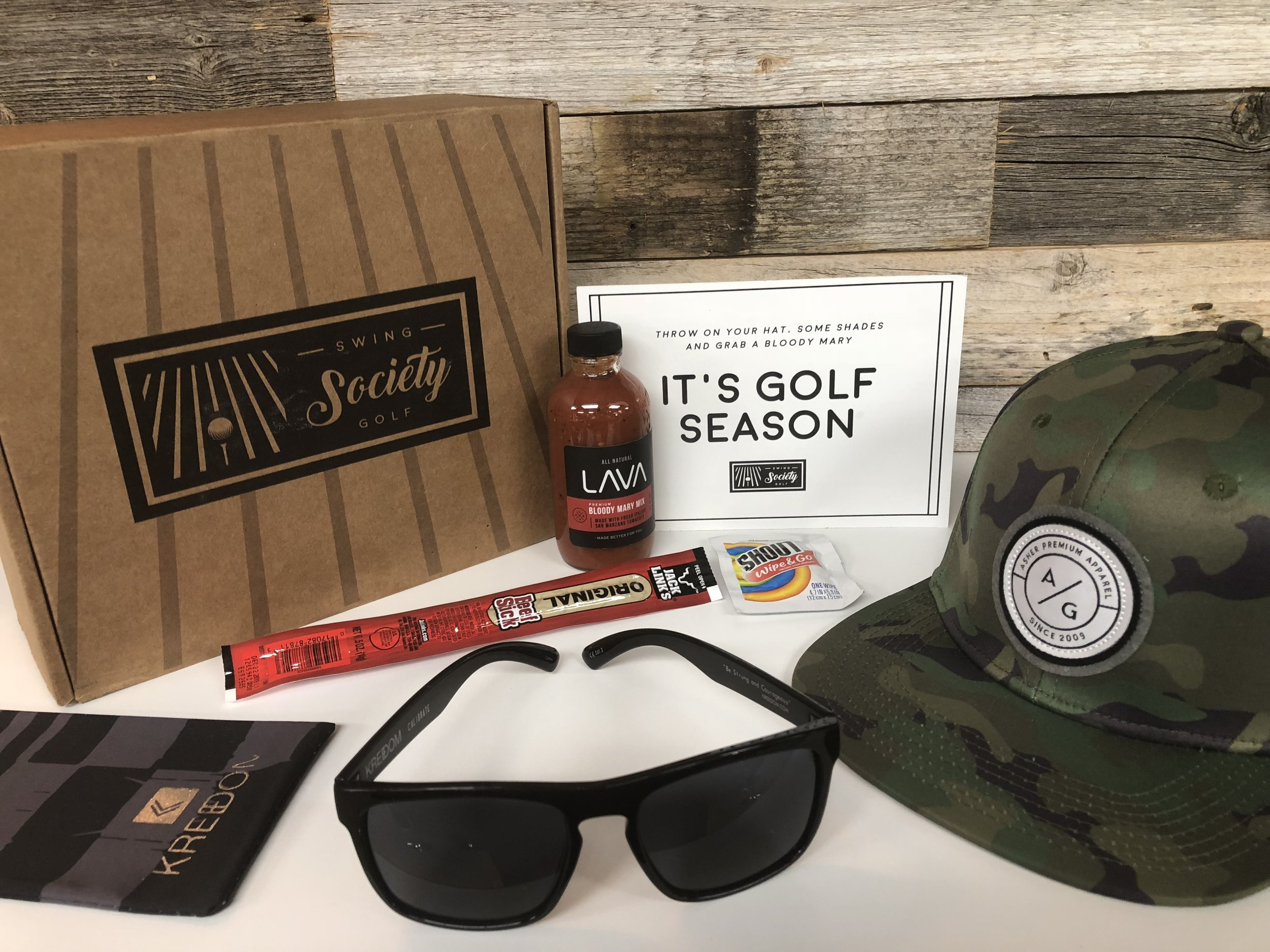 CONTENTS:   asher golf camo hat [$26]  freedom sunglasses [$30]  lava bloody mary mix [$9]  shout wipes portable stain treater [$1]  jack link's classic beef stick [$2]