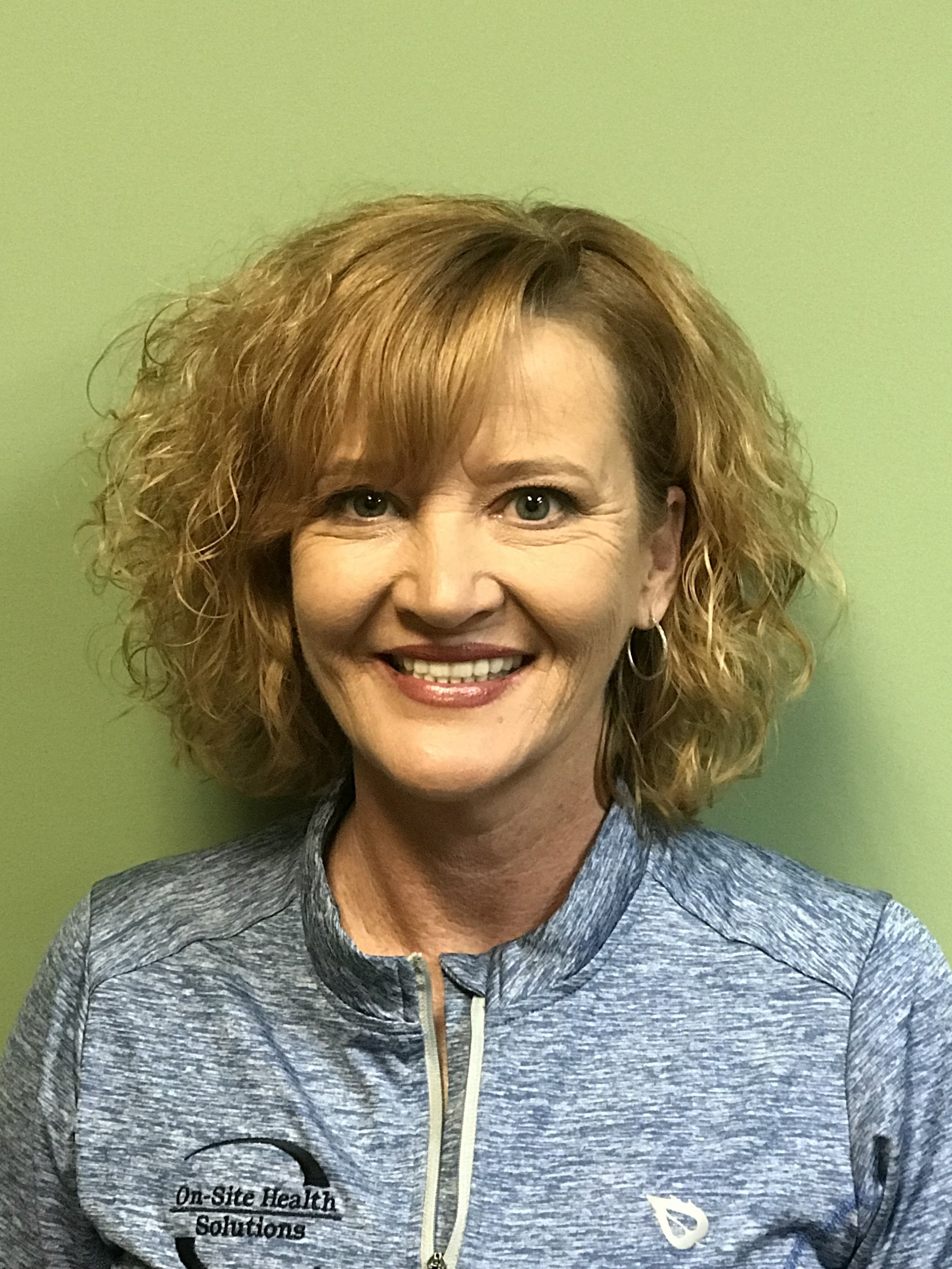 Janna -  Wellness Engagement Specialist  Janna attended the University of Kentucky and graduated from the University of Louisville in 1992 with an Associates degree in radiography. She enjoys playing golf, spending time with her large family and friends, and following the Kentucky Wildcats and Cincinnati Reds.  Janna says the best part of working at OHS is the close knit family atmosphere. She enjoys going on site to different types of workplace environments and providing clients with information about their health they might not otherwise have known without our services.   janna@healthyworksite.com