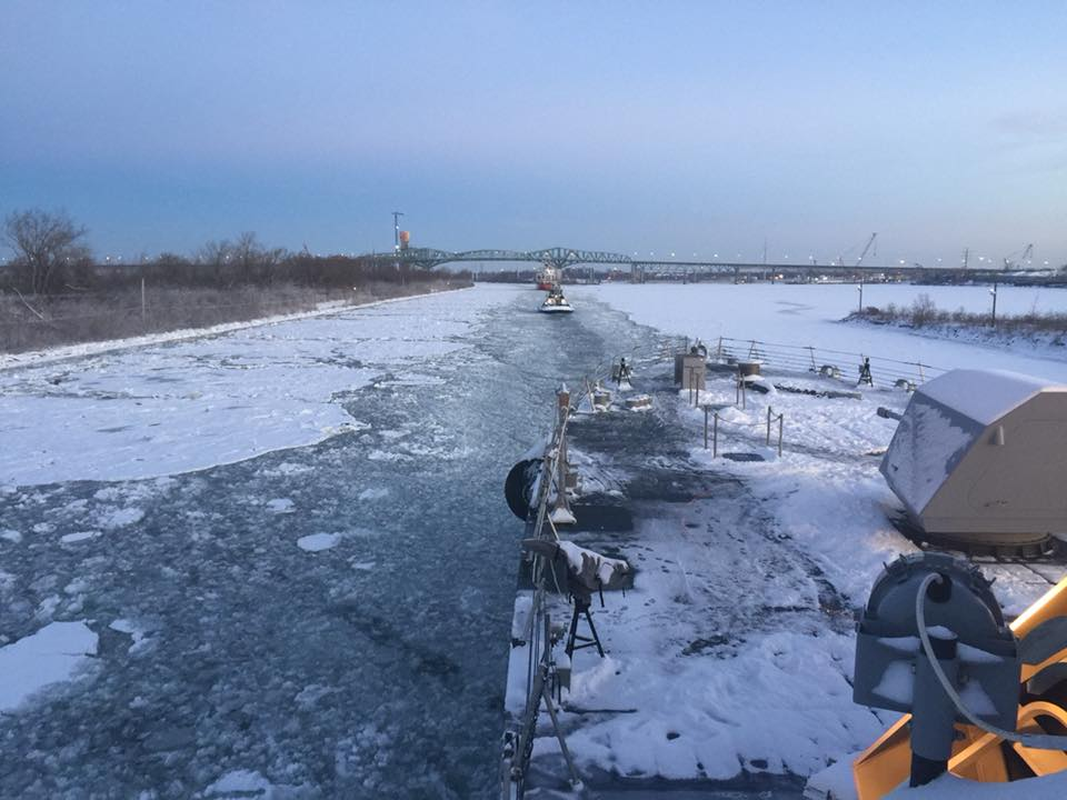This picture was taken today. On the right, it shows the solid ice sheet in Montreal, Canada. Open water is so narrow near shore that only tug boats can pass through it.