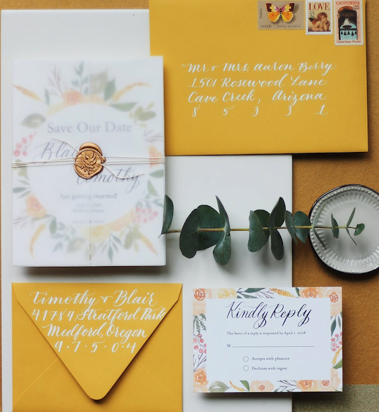 The Blair  The Blair is a stunning statement suite perfect for Spring, Summer and even Autumn weddings! This suite is full of effervescent yellow florals with small hints of pink, as well as hand calligraphed details. The color of the berries is editable at no extra cost for this suite. The Save the Date format pictured above is the invitation format offered for this suite. The Blair starts at $225 for 100 sets of invitations including the invitation, rsvp and blank envelopes for both.. Please request a quote to receive pricing for this suite as pictured, with a vellum and twine wrap, finished with a wax seal and the addition of vintage stamps.