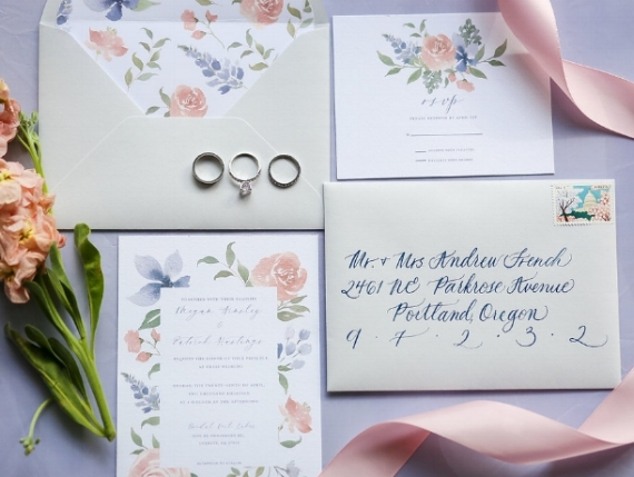 The Allie  The Allie features soft cornflower blue and blush pink hand painted florals. This suite comes with matching envelope liners to round out the suite. The Allie starts at $225 for 100 sets of invitations including the invitation, rsvp card,as well as a blank lined envelope for the invitation and a blank unlined envelope for the rsvp.