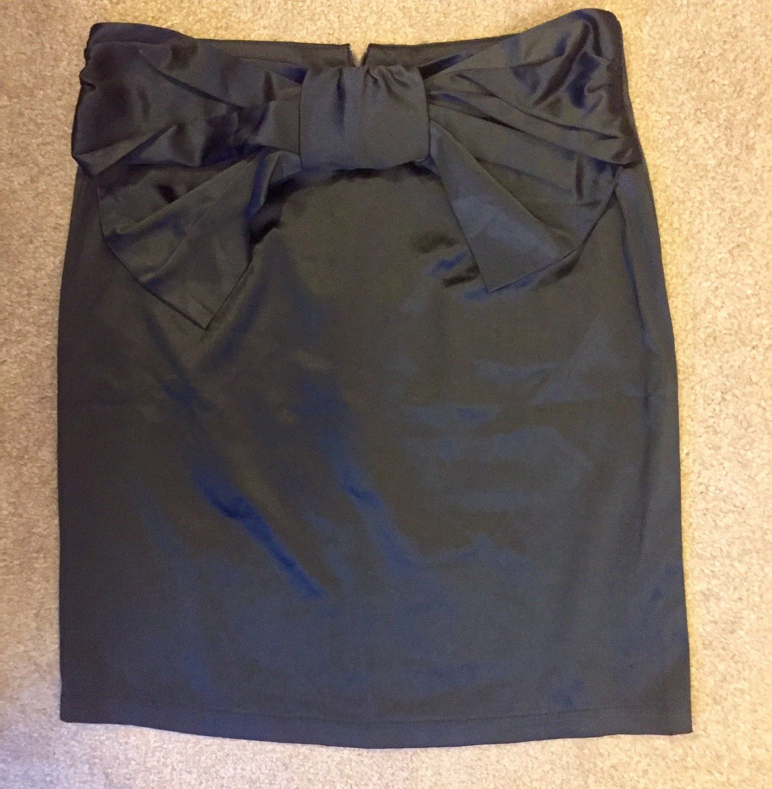 Chanel Mini Skirt with Black Bow (PLEASE NOTE: My photography skills have gotten MUCH better since I first began... also, I researched and researched this piece to make sure it wasn't a fake.) Bought: $4.99 (Goodwill) Listed: $49.99 Sold: $40 Profit: $35.01 (minus eBay's cut)