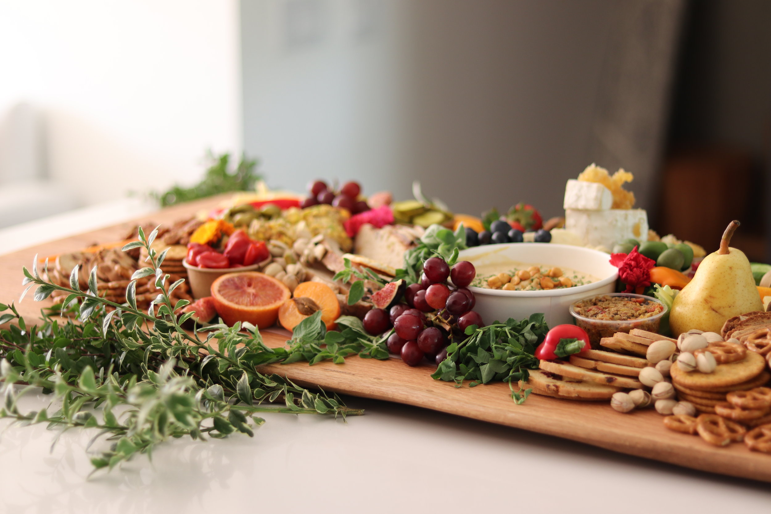 Grazing Boards - Designed for Events Serving 20+Abundantly styled onsite atop our beautiful live-edged Grazing Boards, a stunning stage for a delicious graze.