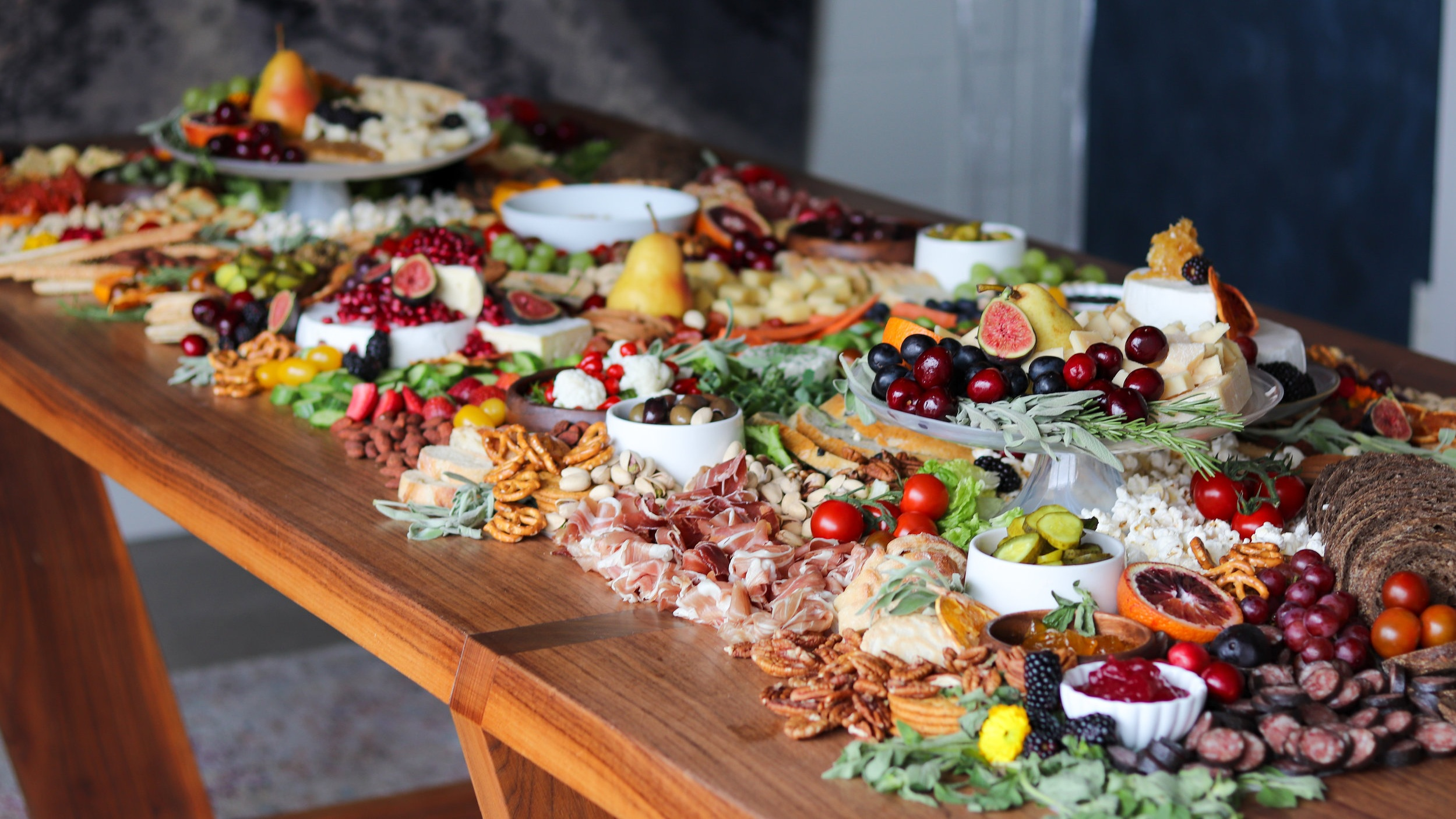 Grazing Tables - Designed for Events Serving 40+Absolute Luxury. This is where Brie & Banquet's artfulness is fully expressed. Voluptuous, elegant and layered displays styled onsite atop any flat, stable surface with our glass, ceramic and wood tiers and displayware.