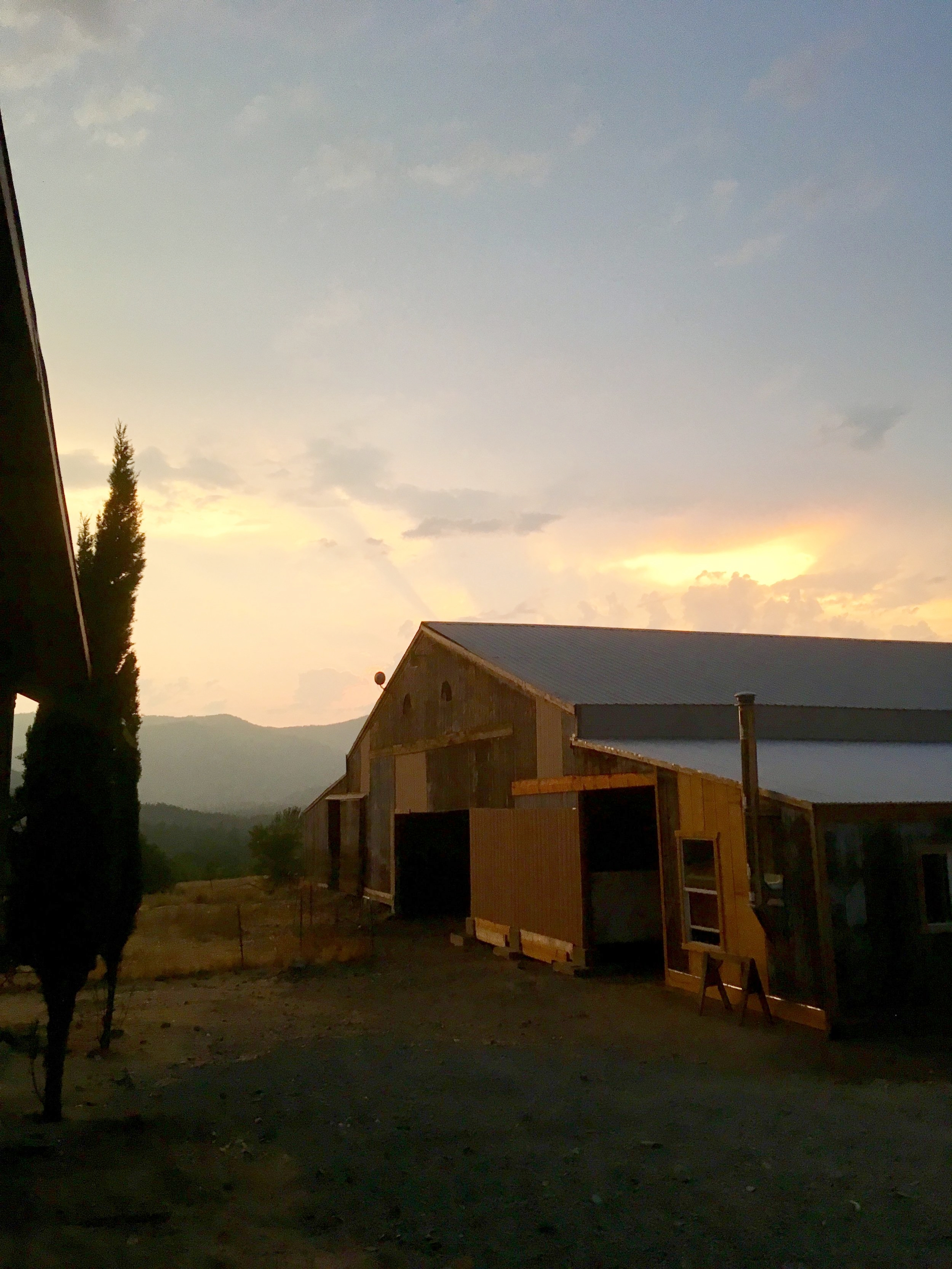 A beautiful summer sunset over the barn.