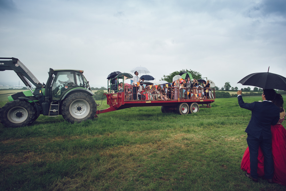Sophie & Mike Wedding at Hunstile Farm - Tractor Transports Guests