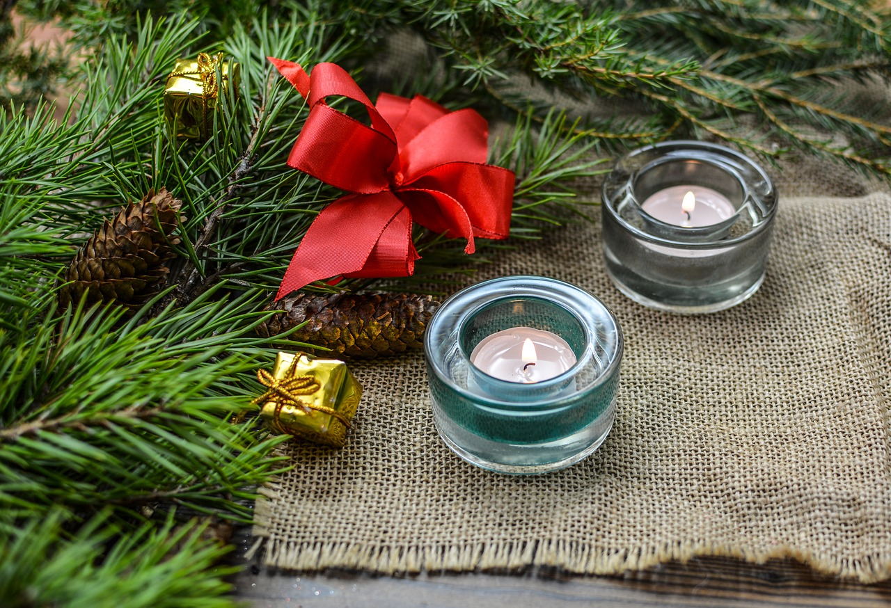 christmas tree branch and tealight candles