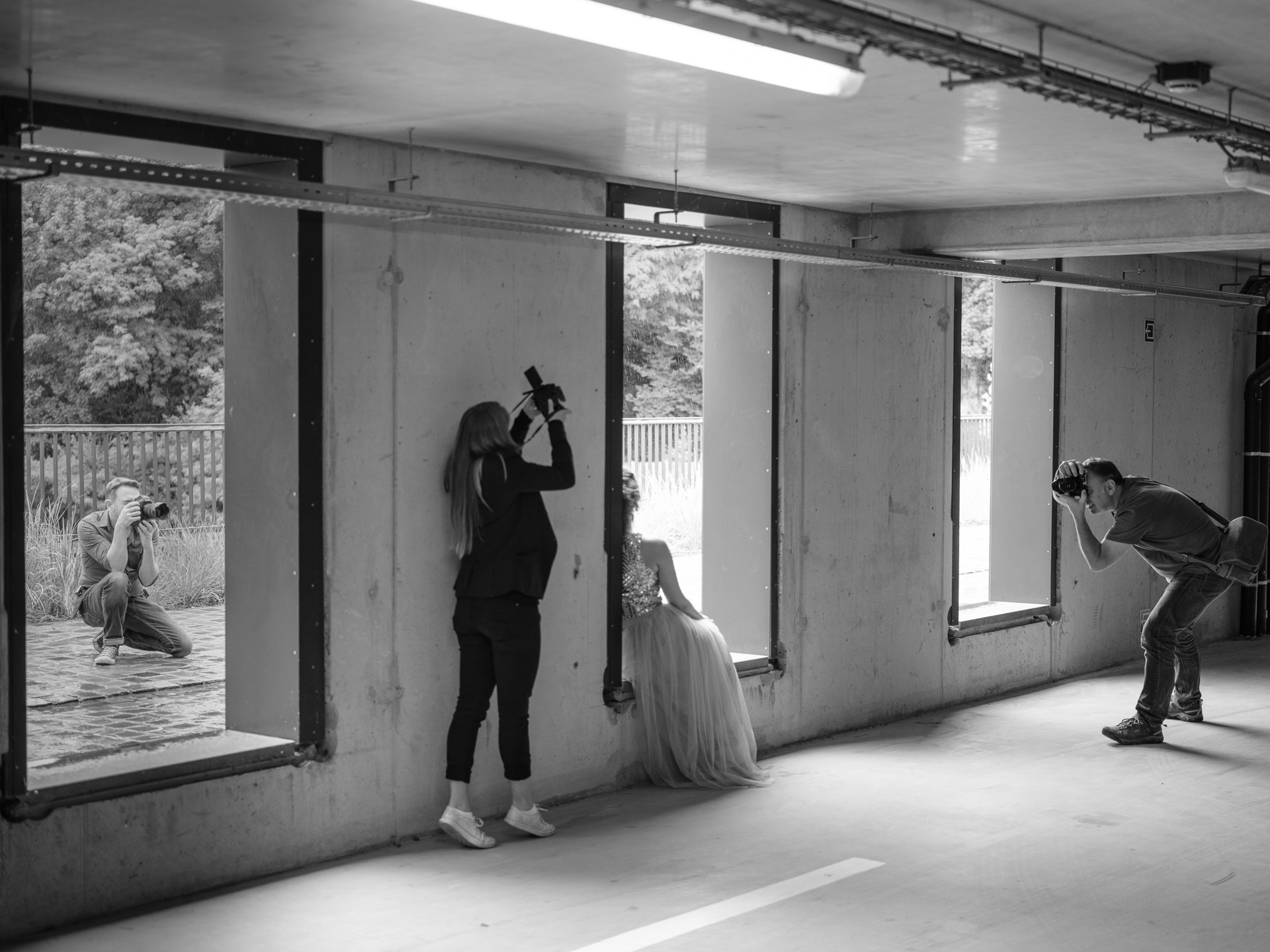 From left to right: Jef taking a behind the scenes shot - Laura looking for a creative angle - Jasmin being her elegant self - Frank looking for his next composition