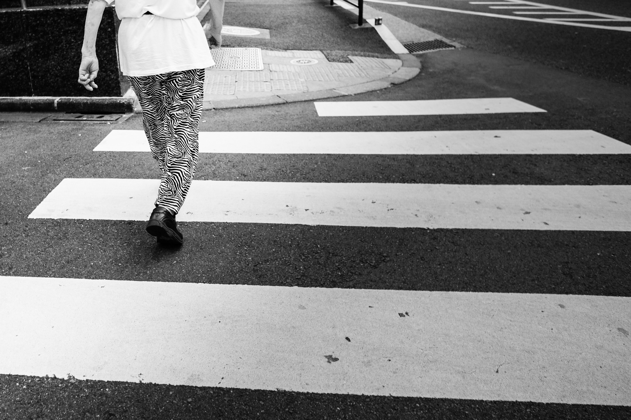 Fujifilm X-Pro1 - 14mm f/2.8 - 1/600 - f/4 - iso400 When I noticed this lady's zebra pants, I started stalking her, hoping she would walk over a pedestrian crossing to match the pattern ... after 10 minutes she did.