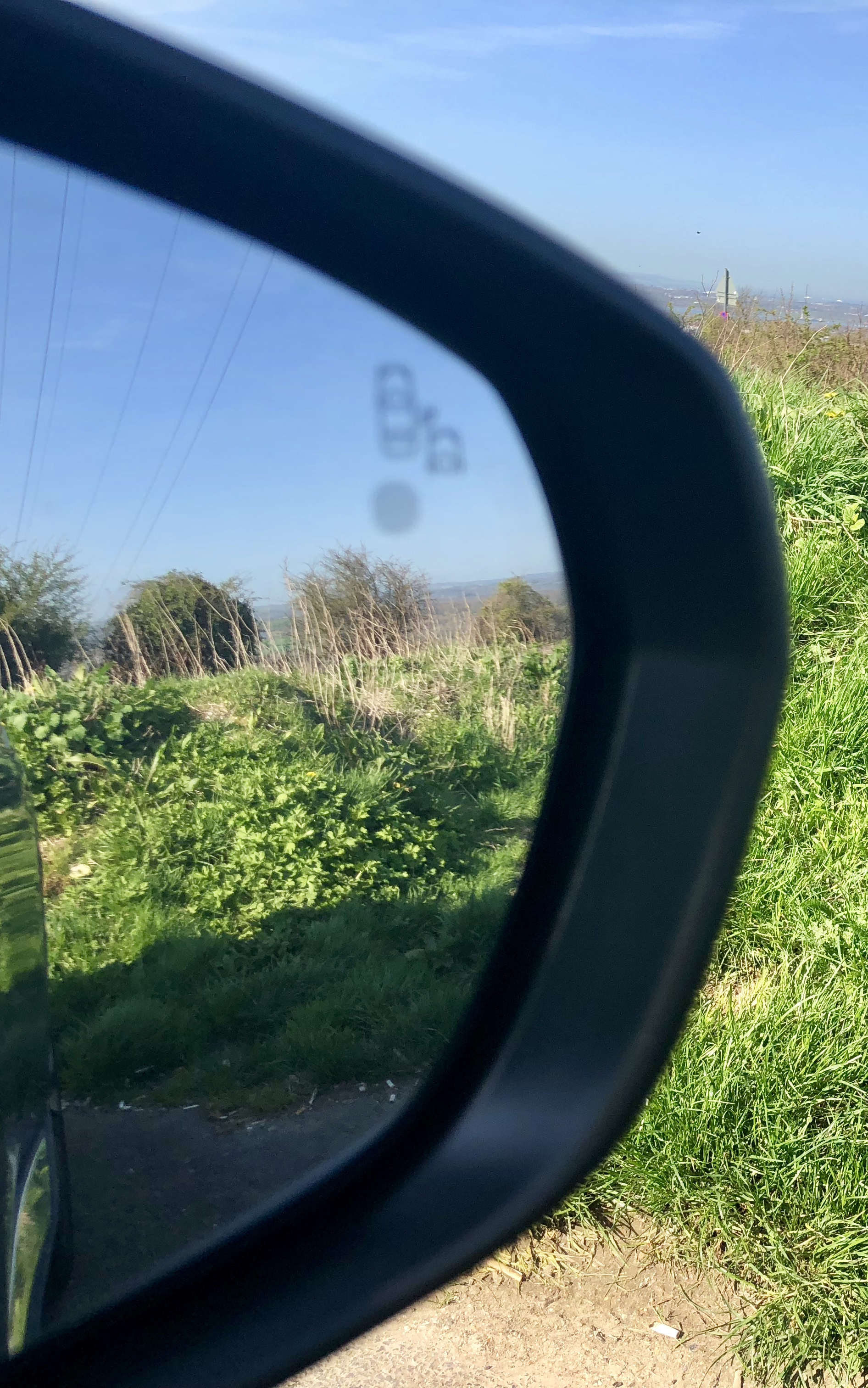 Blind spot recognition, in the door mirrors.