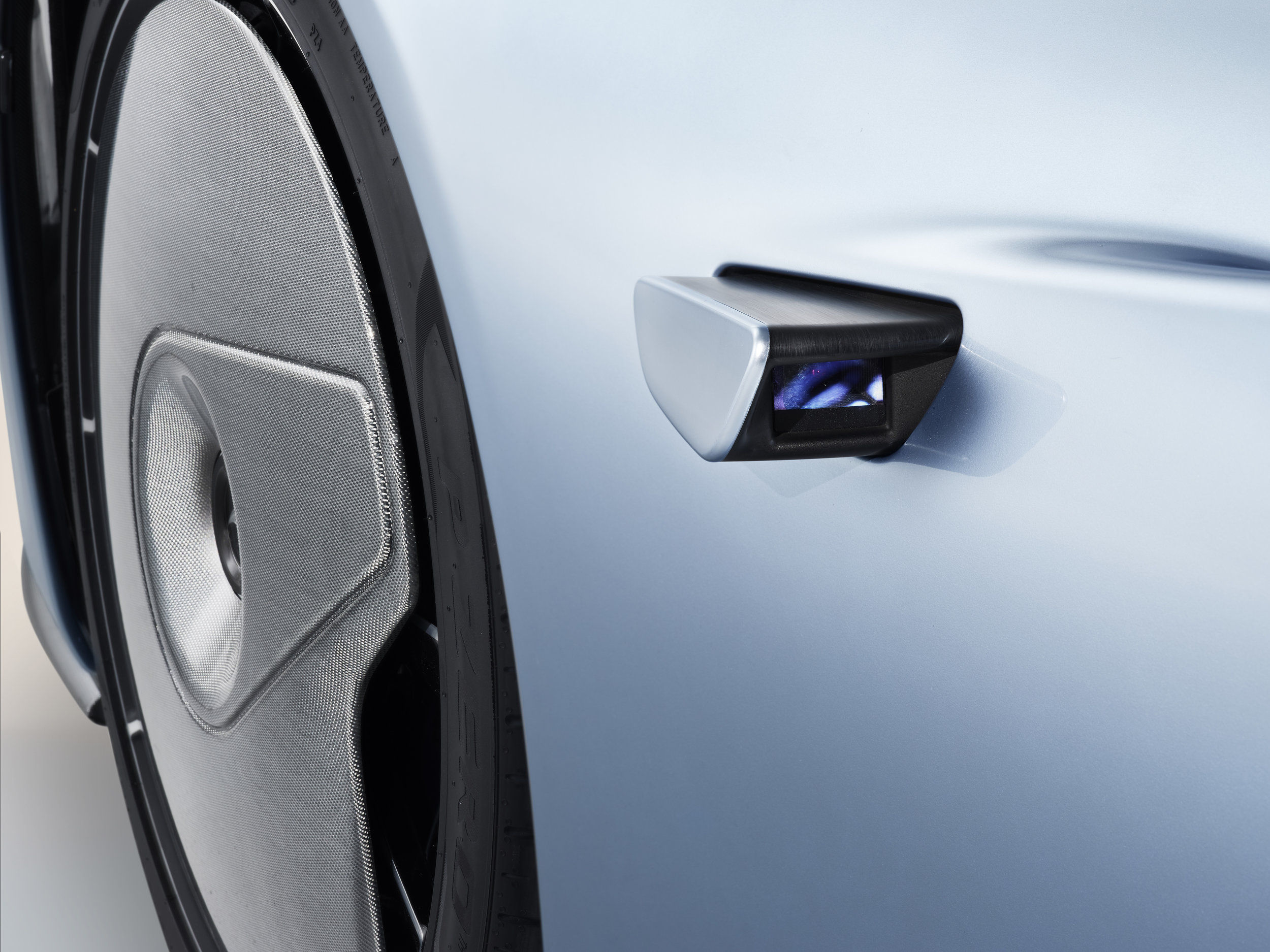 External cameras replace wing / door mirrors. Images are then shown on monitors to the side of the driver.