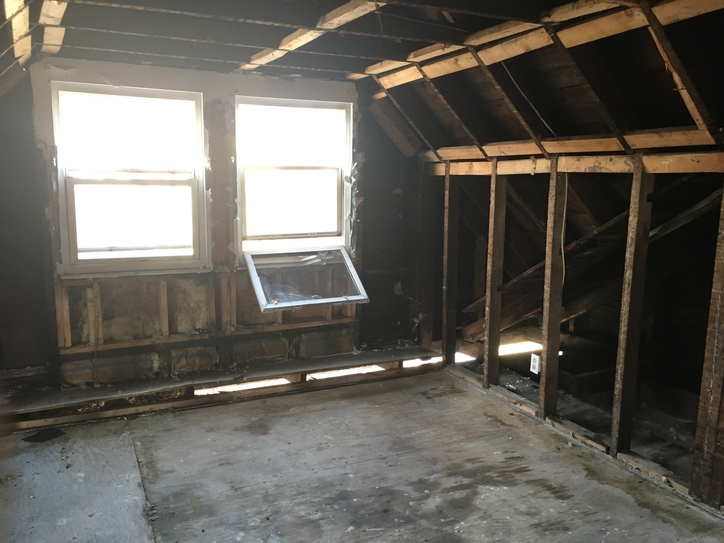 Before: bedroom #3. You could see outside through the damage in the joists.