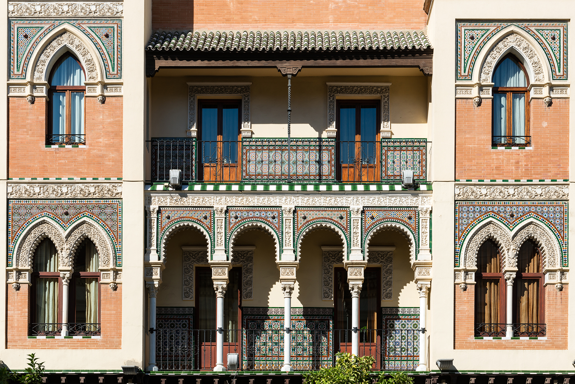 Front neo-mudejar facade of a traditional house in Seville