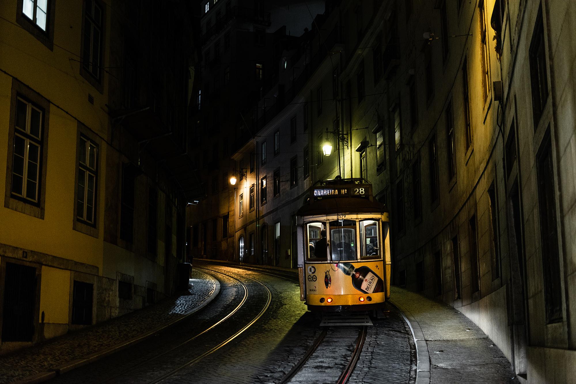 Yellow tram in Lisbon at night