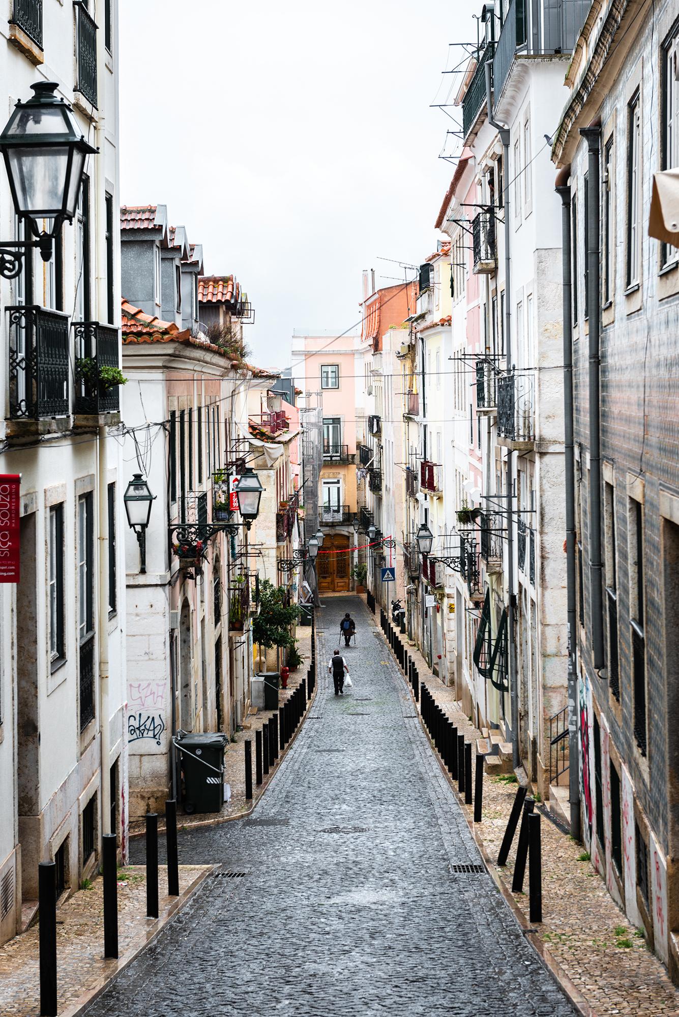 Traditional narrow cobblestone street in the Barrio Alto district