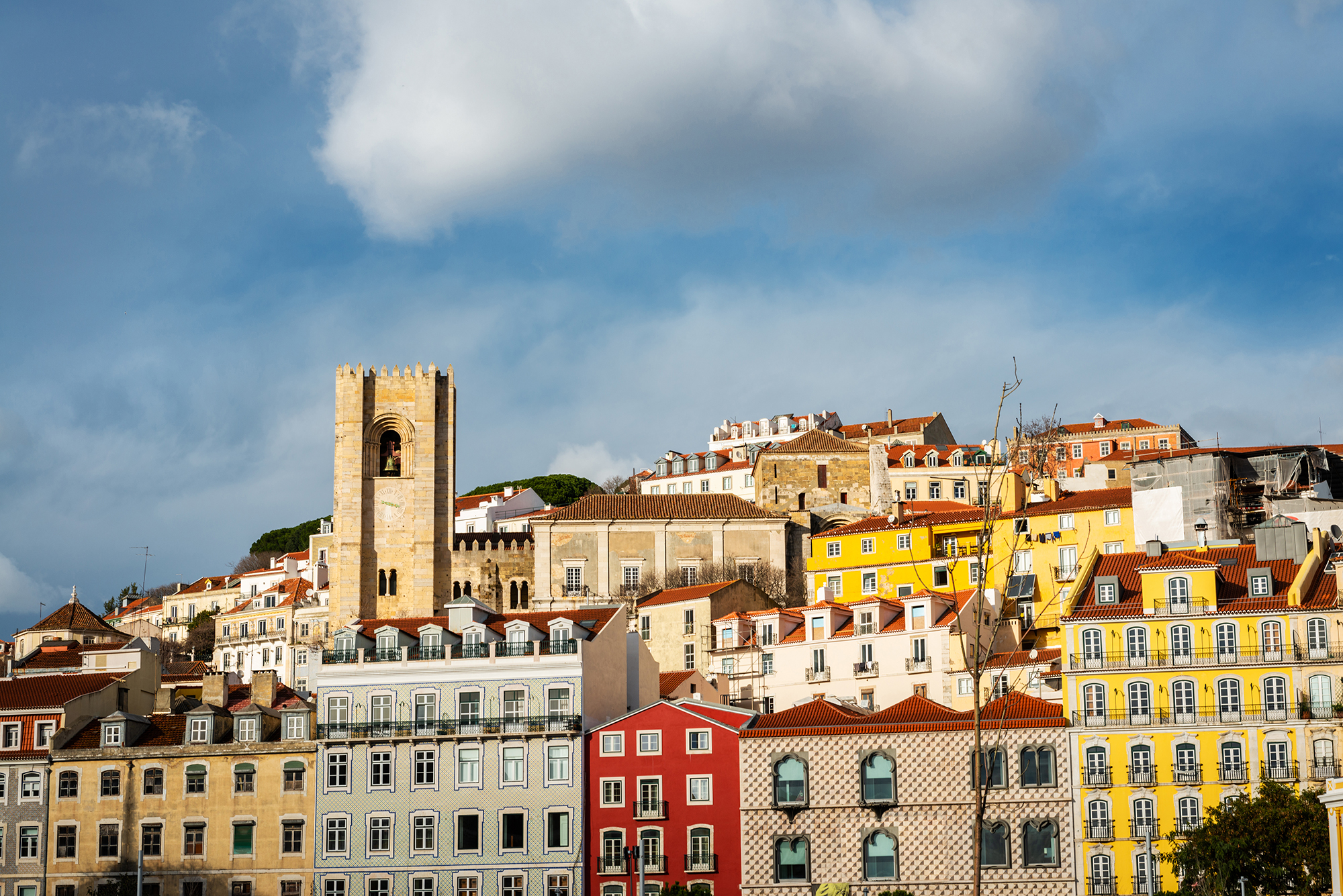 Skyline with the towers of the cathedral and colourful houses of the Alfama district